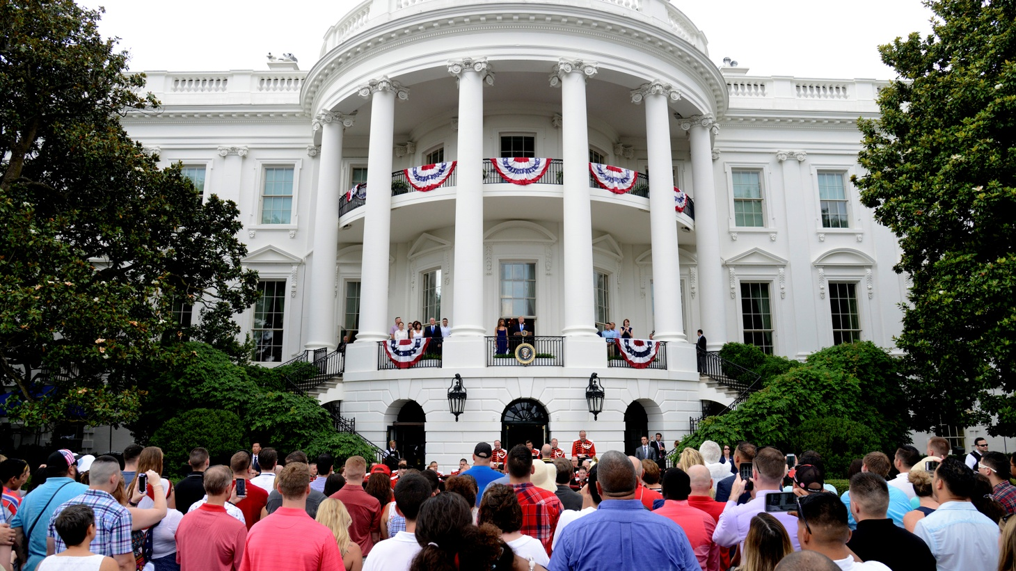 President Donald Trump and First Lady Melania Trump (C), along with Vice President Mike Pence and his wife Karen, stand at Truman Balcony as they welcome military families who have gathered for a Fourth of July picnic on the South Lawn of the White House, prior to a fireworks display, in Washington, U.S. July 4, 2017.