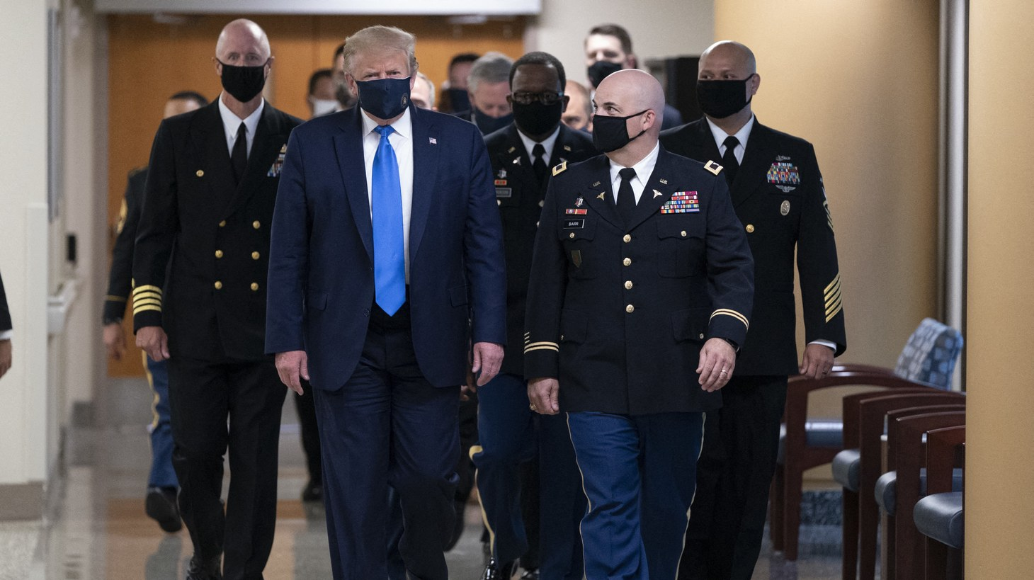 """President Donald Trump arrives at Walter Reed National Military Medical Center to visit with wounded military members and front line coronavirus healthcare workers in Bethesda, MD, USA. US President Donald Trump has worn a mask in public for the first time since the start of the coronavirus pandemic. The president was visiting the Walter Reed military hospital outside Washington, where he met wounded soldiers and health care workers. """"I've never been against masks but I do believe they have a time and a place,"""" he said as he left the White House. He has previously said that he would not wear a mask and mocked Democratic rival Joe Biden for doing so."""