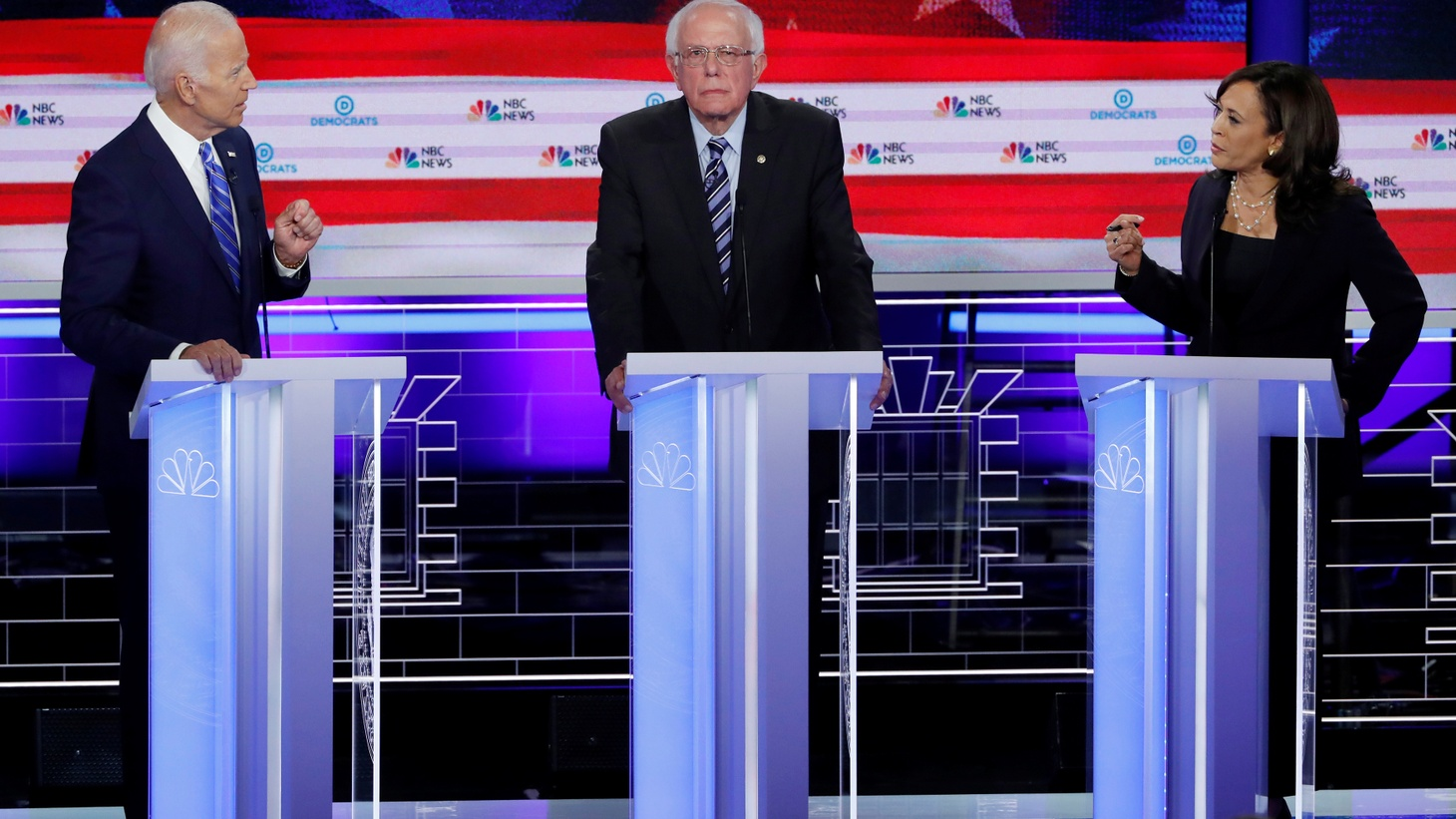 Former Vice President Joe Biden and Senator Kamala Harris debate racial issues as Senator Bernie Sanders listens during the second night of the first U.S. Democratic presidential candidates 2020 election debate in Miami, Florida, U.S., June 27, 2019.