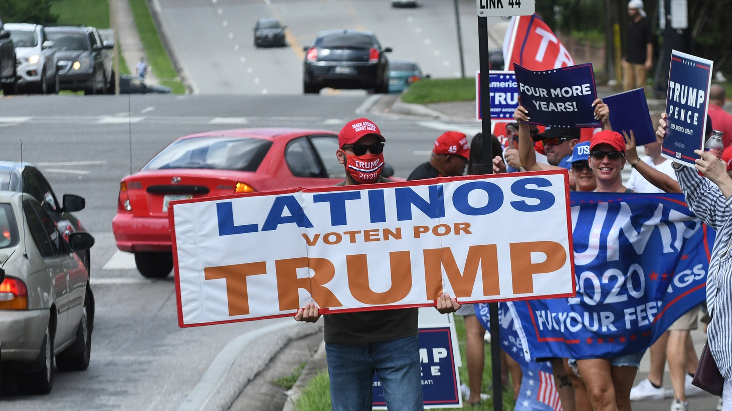 People hold placards after U.S. Vice President Mike Pence addressed supporters at a Latinos for Trump campaign rally at Central Christian University on October 10, 2020 in Orlando, Florida. With 24 days until the 2020 presidential election, both Donald Trump and Democrat Joe Biden are courting the Latino vote as Latinos are the largest racial or ethnic minority in the electorate, with 32 million eligible voters.
