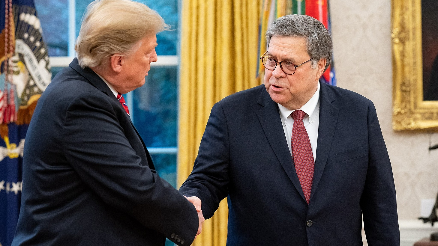 President Donald Trump shaking hands with William Barr