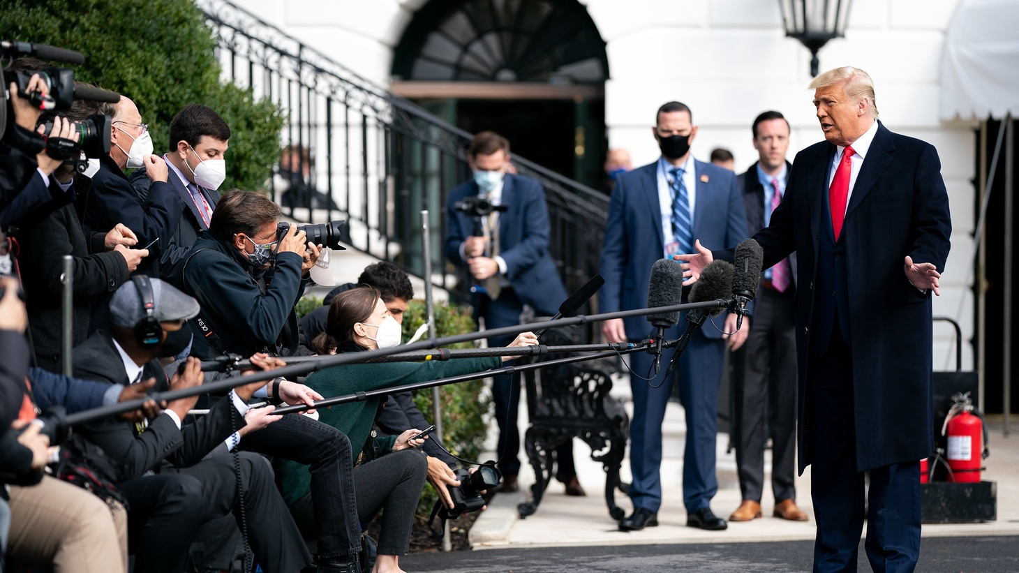 President Donald J. Trump talks to members of the press along the South Lawn driveway of the White House Friday, Oct. 30, 2020, prior to boarding Marine One en route to Joint Base Andrews, Md. to begin his trip to Michigan, Wisconsin and Minnesota.