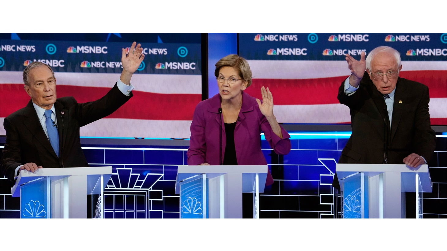 Senator Elizabeth Warren speaks as former New York City Mayor Mike Bloomberg and Senator Bernie Sanders try to get the moderators attention at the ninth Democratic 2020 U.S. Presidential candidates debate at the Paris Theater in Las Vegas, Nevada, U.S., February 19, 2020.