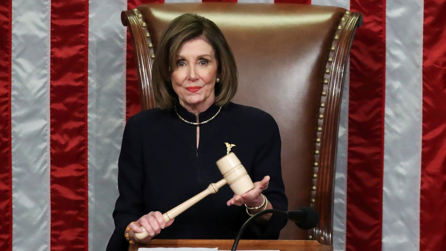 U.S. Speaker of the House Nancy Pelosi (D-CA) wields the Speaker's gavel as she presides over the final of two House of Representatives votes approving two counts of impeachment against U.S. President Donald Trump in the House Chamber of the U.S. Capitol in Washington, U.S., December 18, 2019.