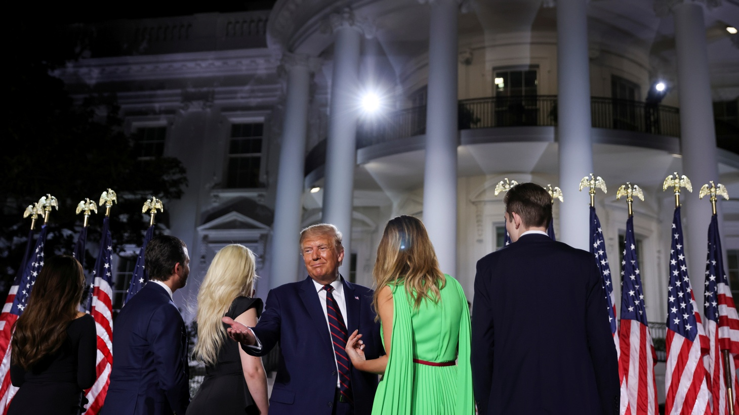 U.S. President Donald Trump gestures to the crowd as he stands with first lady Melania Trump, his son Barron and the rest of his extended family after delivering his acceptance speech as the 2020 Republican presidential nominee during the final event of the Republican National Convention on the South Lawn of the White House in Washington, U.S., August 27, 2020.