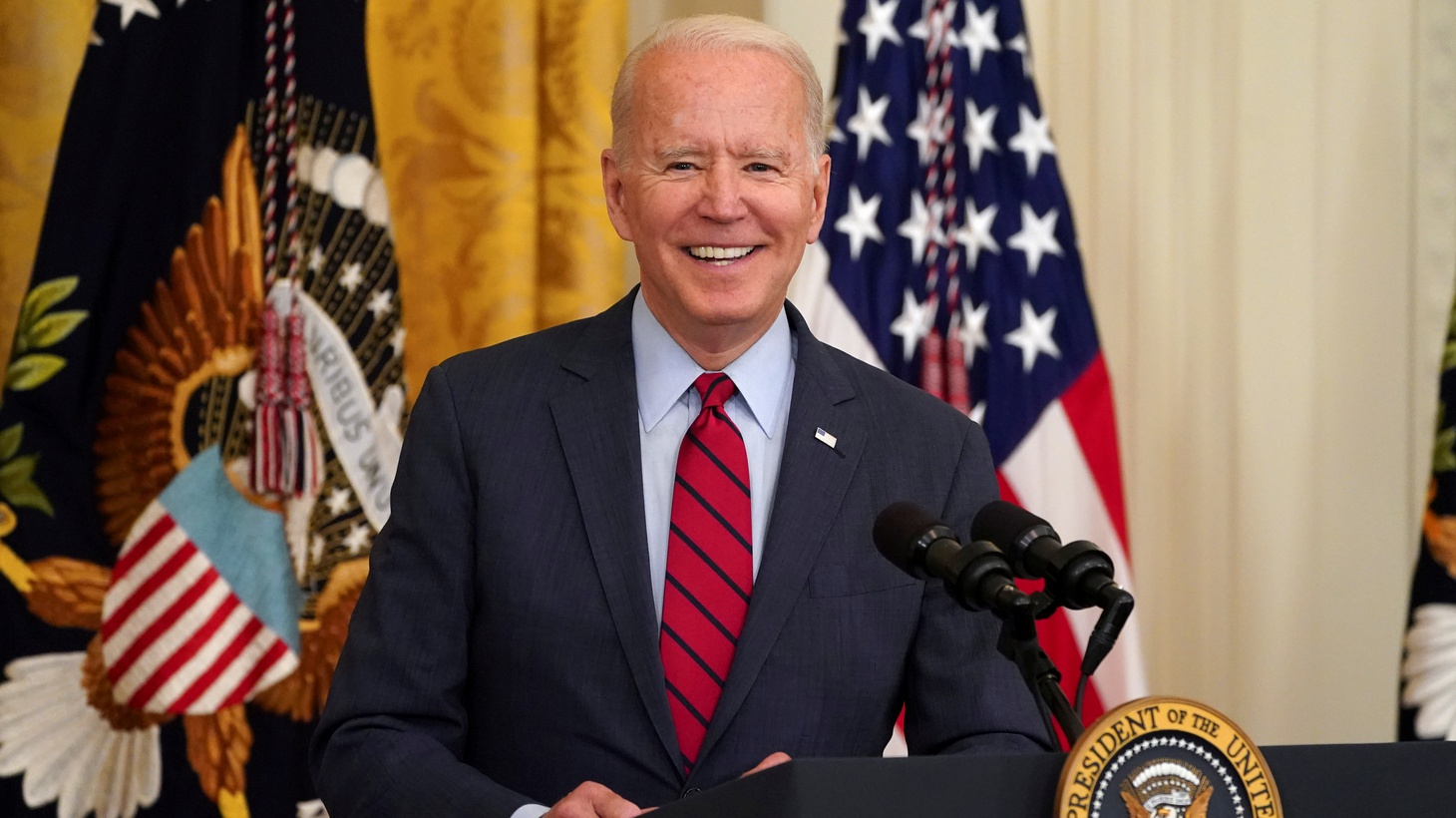 U.S. President Joe Biden smiles as he delivers remarks on the bipartisan infrastructure deal in the East Room of the White House in Washington, U.S., June 24, 2021.