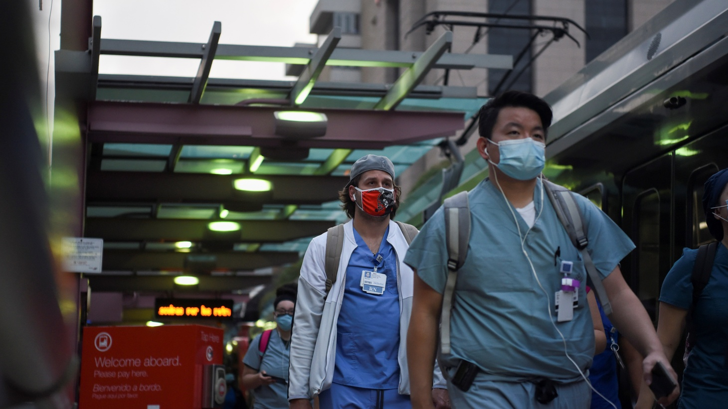 Healthcare workers walk through the Texas Medical Center during a shift change as cases of the coronavirus disease (COVID-19) spike in Houston, Texas, U.S., July 8, 2020.