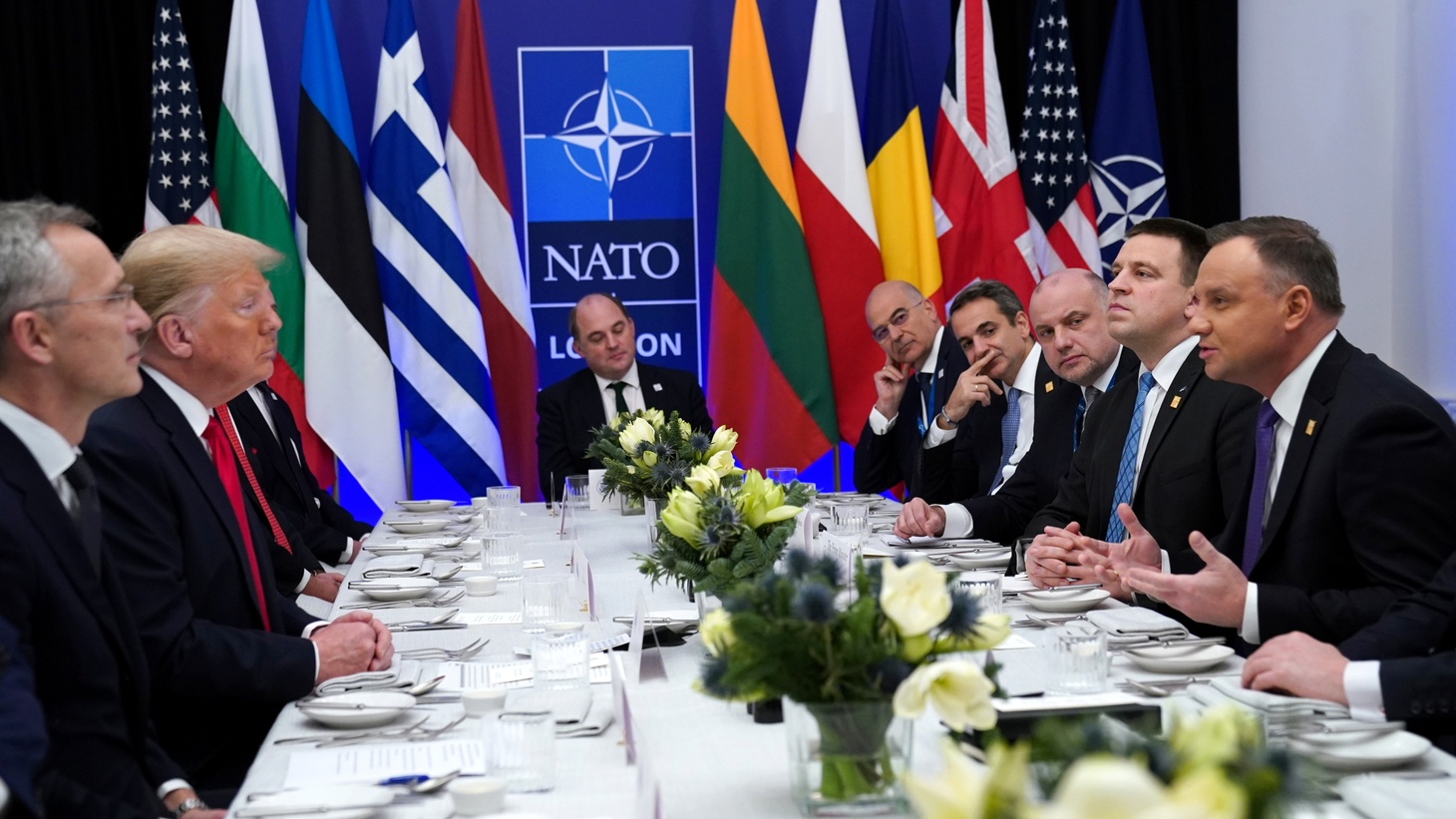 NATO Secretary General Jens Stoltenberg looks on as U.S. President Donald Trump and Poland's President Andrzej Duda talk during a working lunch during the NATO leaders summit in Watford, Britain, December 4, 2019.