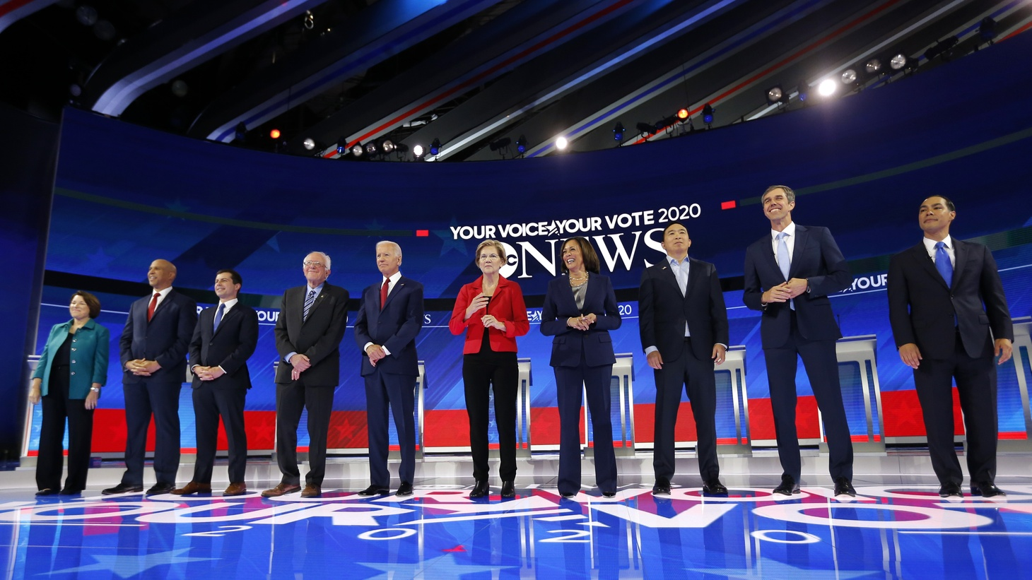 Democratic U.S. presidential candidates Senator Amy Klobuchar, Senator Cory Booker, South Bend Mayor Pete Buttigieg, Senator Bernie Sanders, former Vice President Joe Biden, Senator Elizabeth Warren, Senator Kamala Harris, entrepreneur Andrew Yang, former Rep. Beto O'Rourke and former Housing Secretary Julian Castro pose before the start at the 2020 Democratic U.S. presidential debate in Houston, Texas, September 12, 2019.