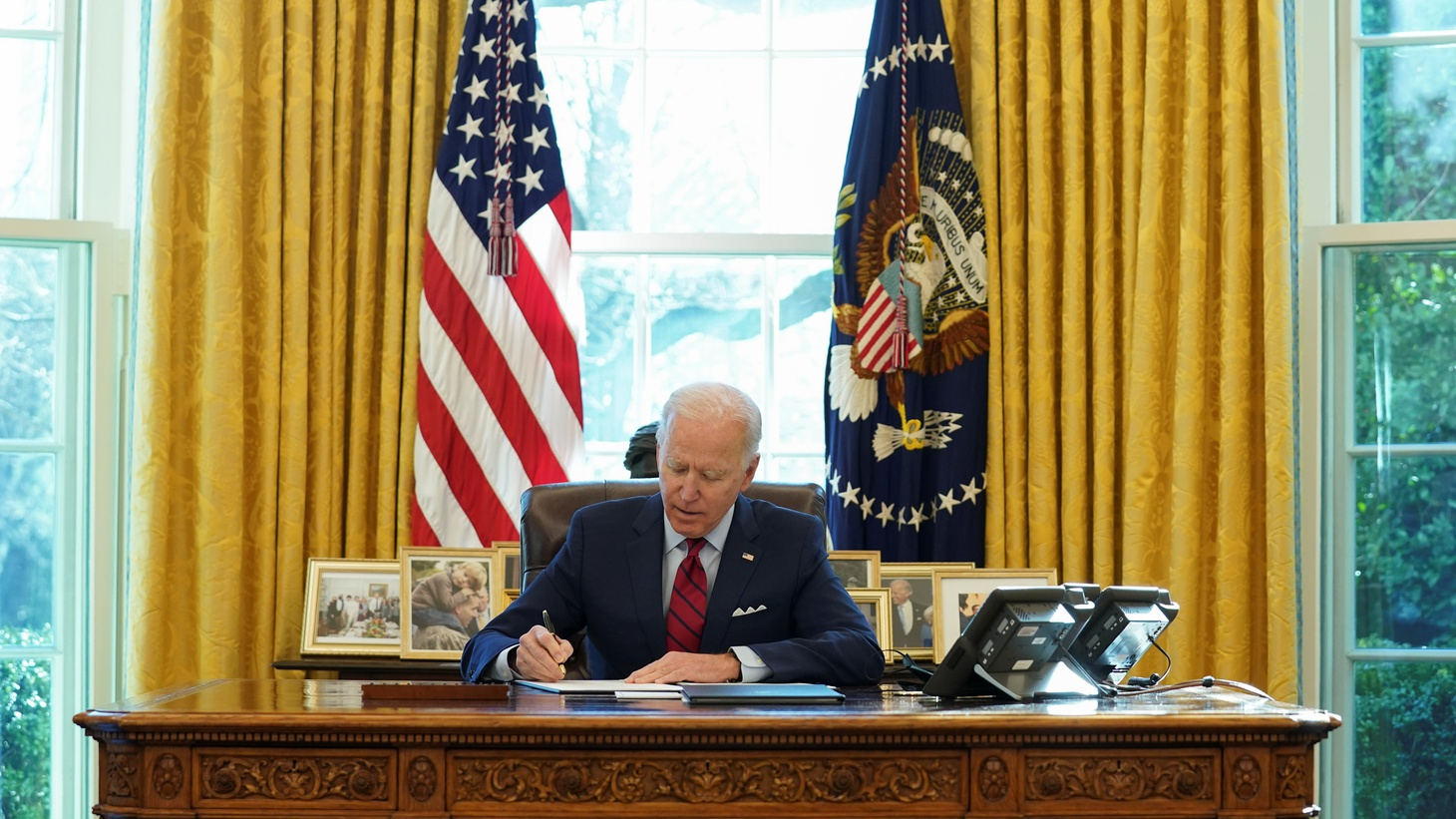 U.S. President Joe Biden signs executive orders strengthening access to affordable healthcare at the White House in Washington, U.S., January 28, 2021.