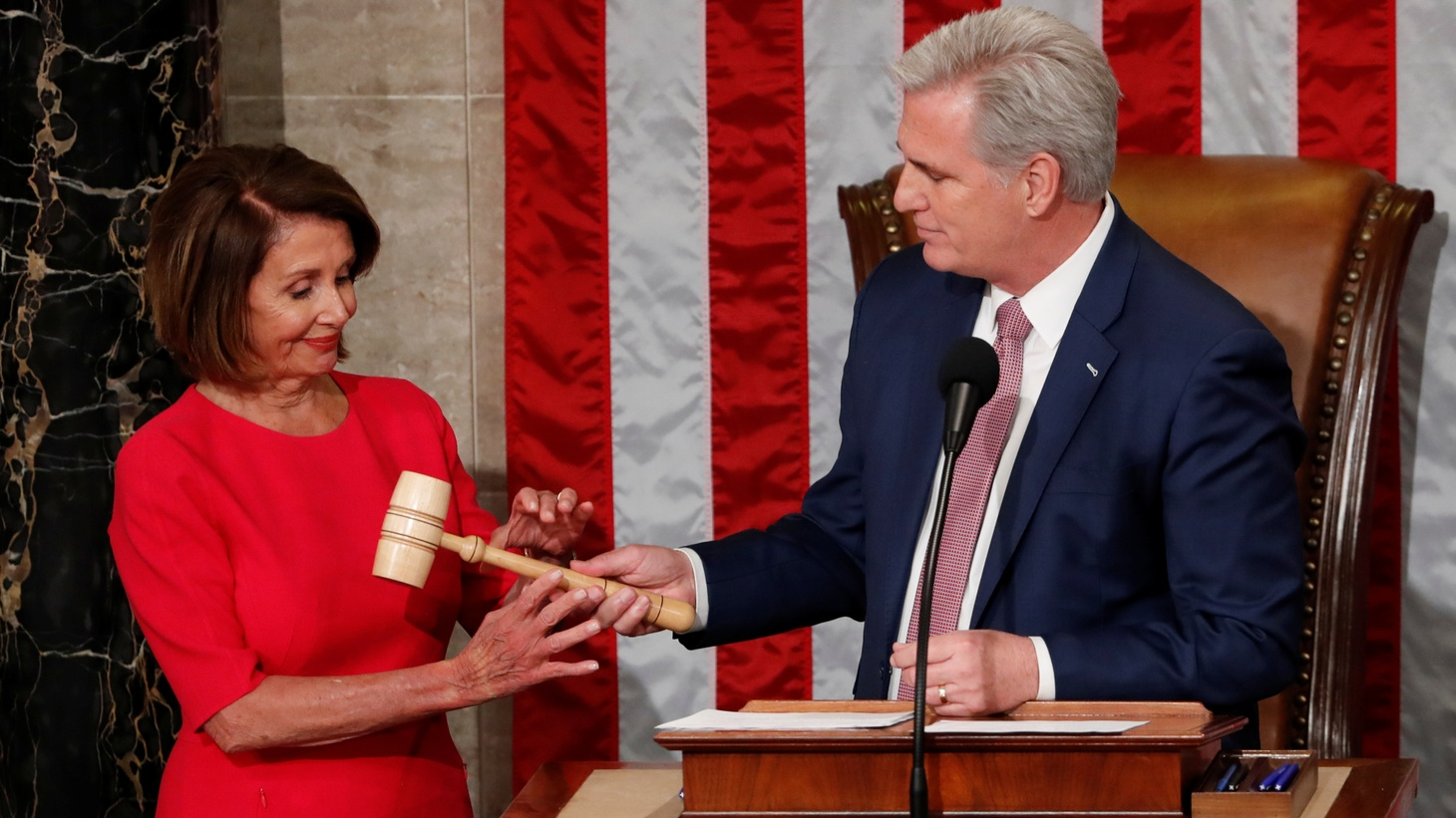 Nancy Pelosi (D-CA) is handed the gavel by House Republican Leader Kevin McCarthy (R-CA) after being elected as Speaker of the House during the start of the 116th Congress in the Capitol in Washington, U.S., January 3, 2019.