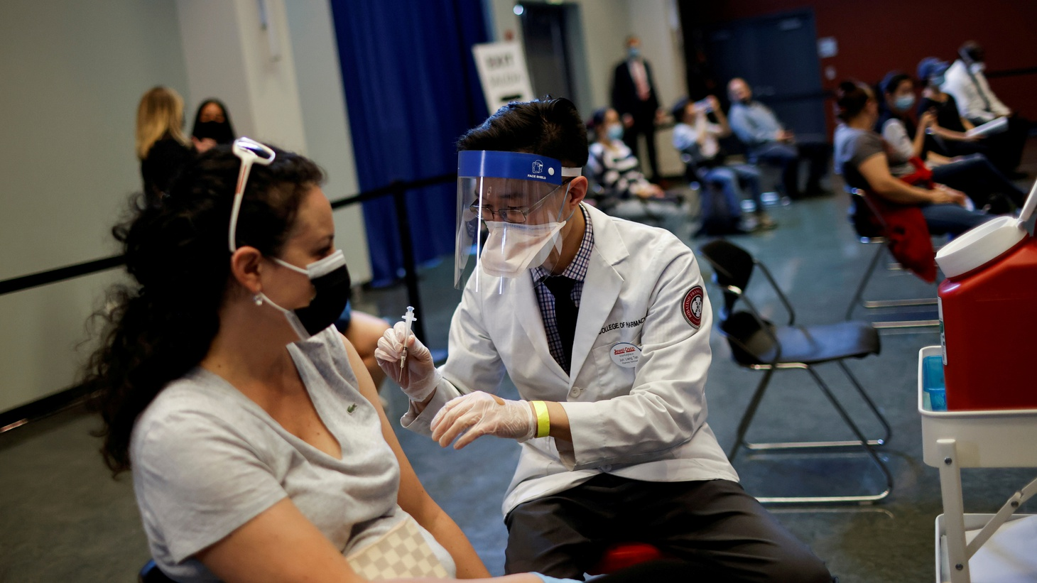 A woman receives a dose of the Johnson & Johnson coronavirus disease (COVID-19) vaccine at vaccination center in Chinatown, in Chicago, Illinois, U.S., April 6, 2021.