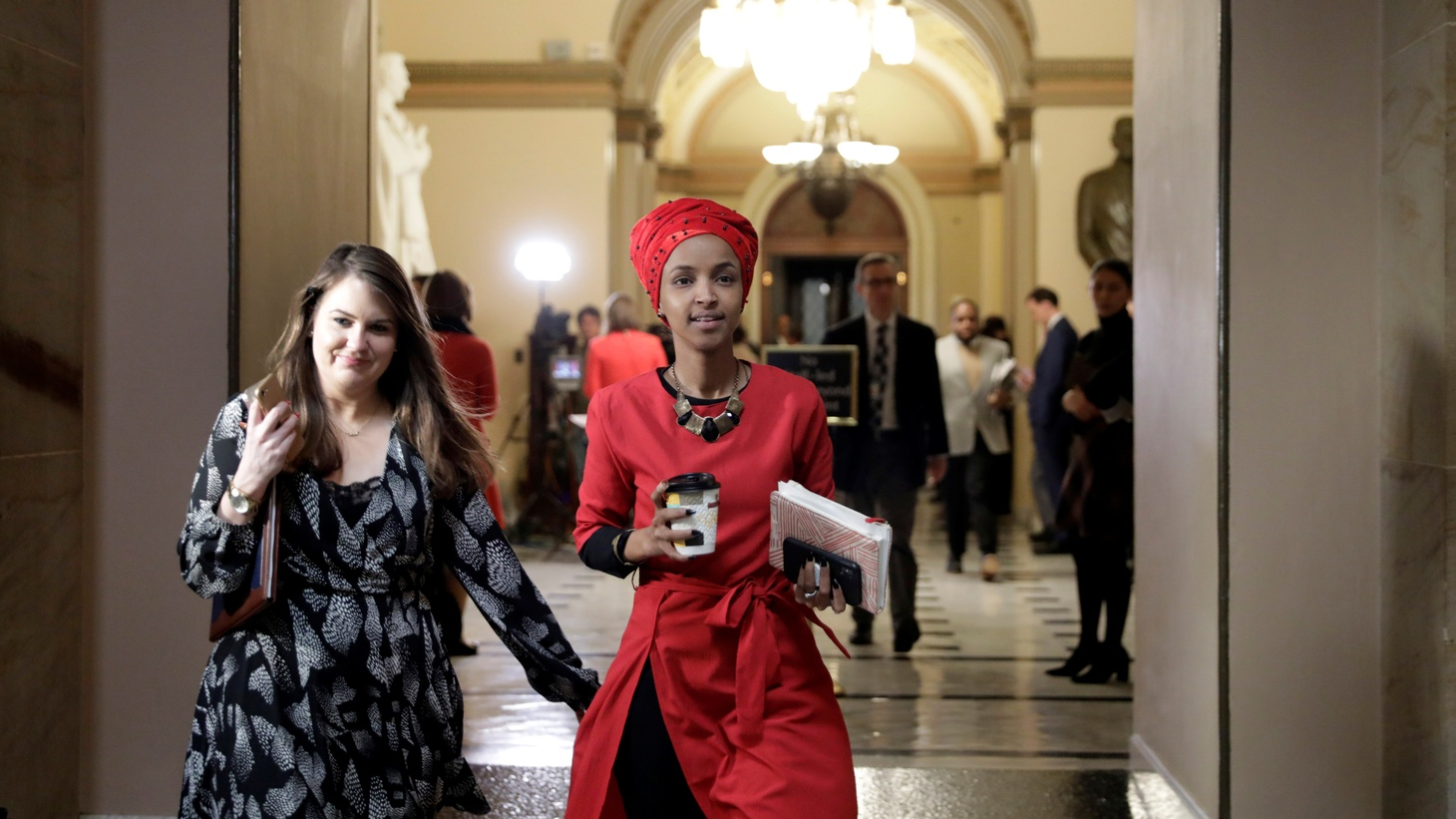 U.S. Rep. Ilhan Omar (D-MN) (R) walks on Capitol Hill in Washington, U.S., January 16, 2019.