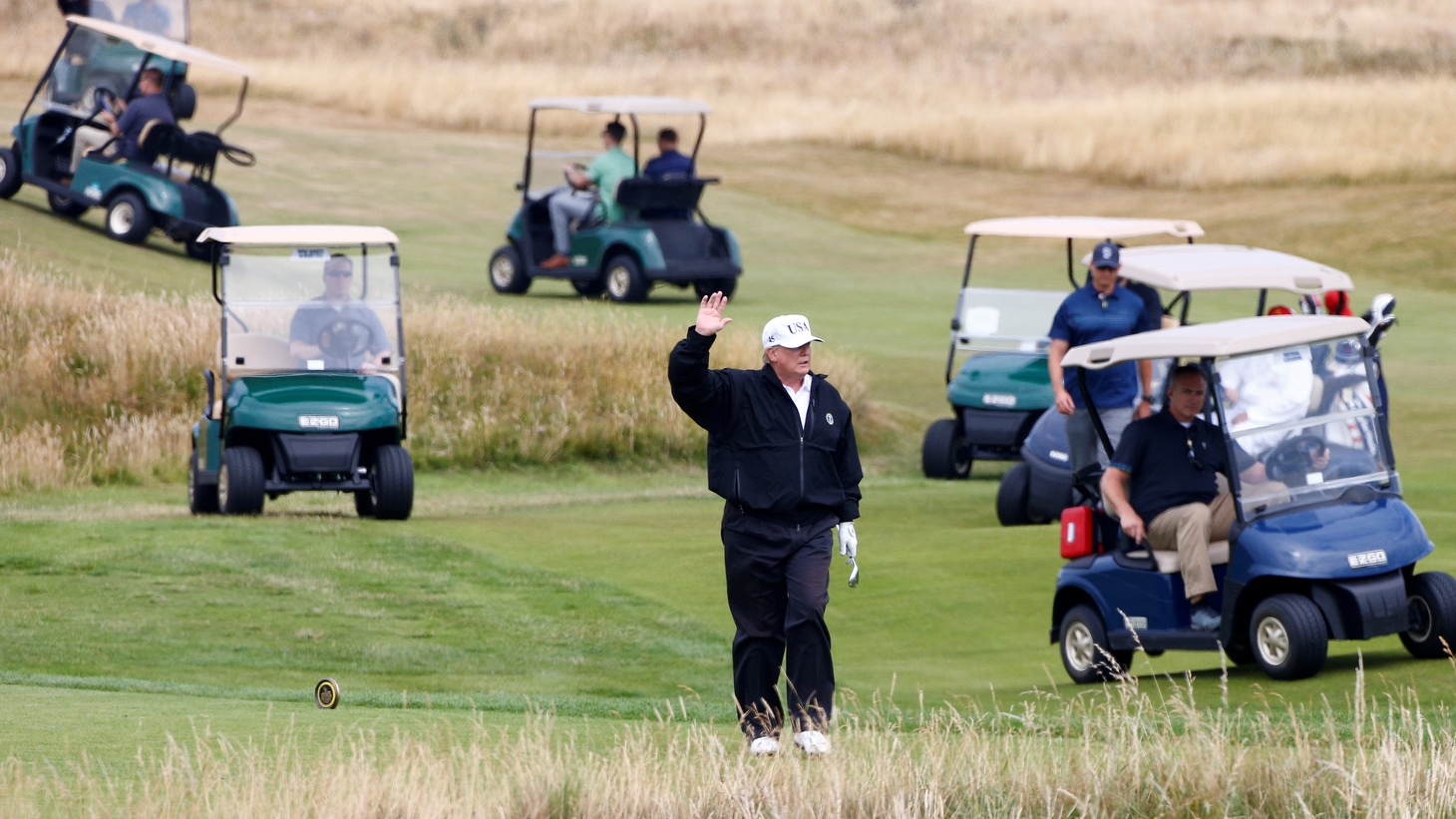 U.S. President Donald Trump gestures as he walks on the course of his golf resort, in Turnberry, Scotland July 14, 2018.