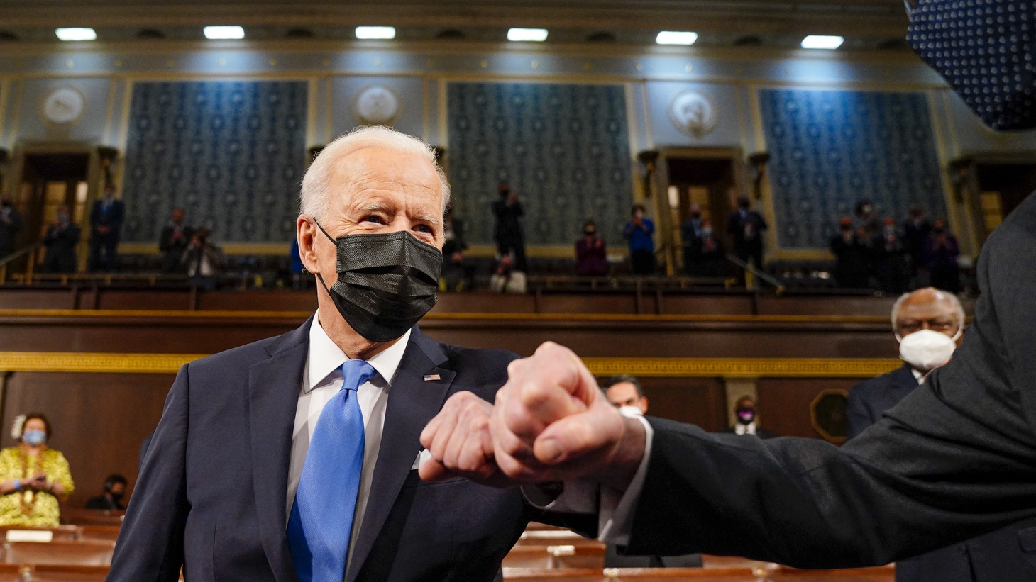 President Joe Biden fist bumps Sen. Patrick J. Leahy (D-Vt.) as he arrives for his the address to a joint session of Congress, with Vice President Kamala Harris and House Speaker Nancy Pelosi (D-Calif.) on the dais behind him, on Wednesday, April 28, 2021. Biden spoke to a nation seeking to emerge from twin crises of pandemic and economic slide in his first speech to a joint session of Congress.