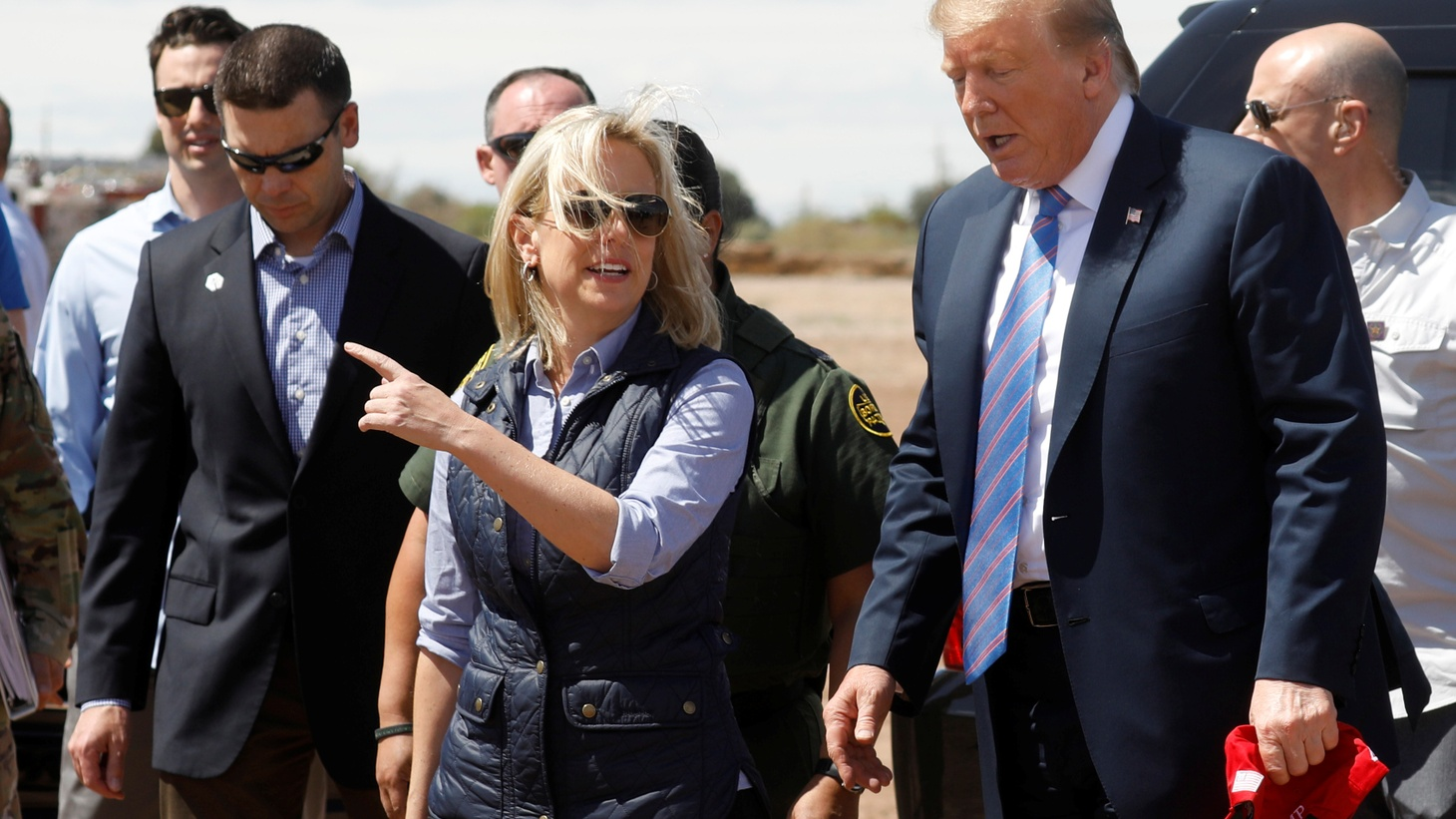 Homeland Security Secretary Kirstjen Nielsen (C) and commissioner for Customs and Border Patrol Kevin McAleenan (L) walk with U.S. President Donald Trump during a visit to a section of the border wall in Calexico California, U.S., April 5, 2019. Picture taken April 5, 2019.