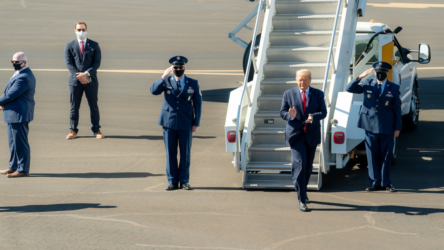 President Donald J. Trump disembarks Air Force One at Laughlin/Bullhead International Airport in Bullhead, Ariz. Wednesday, Oct. 28, 2020, and departs en route to Signature Flight Support.