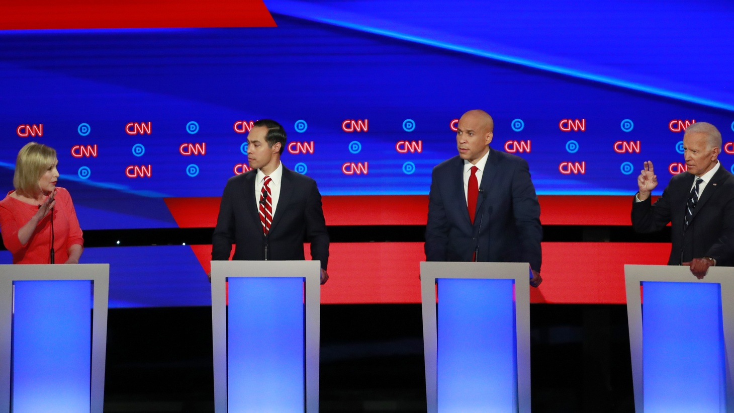 U.S. Senator Kirsten Gillibrand talks to former Vice President Joe Biden (R) past former HUD Secretary Julian Castro (2nd L) and U.S. Senator Cory Booker (2nd R) on the second night of the second 2020 Democratic U.S. presidential debate in Detroit, Michigan, July 31, 2019.