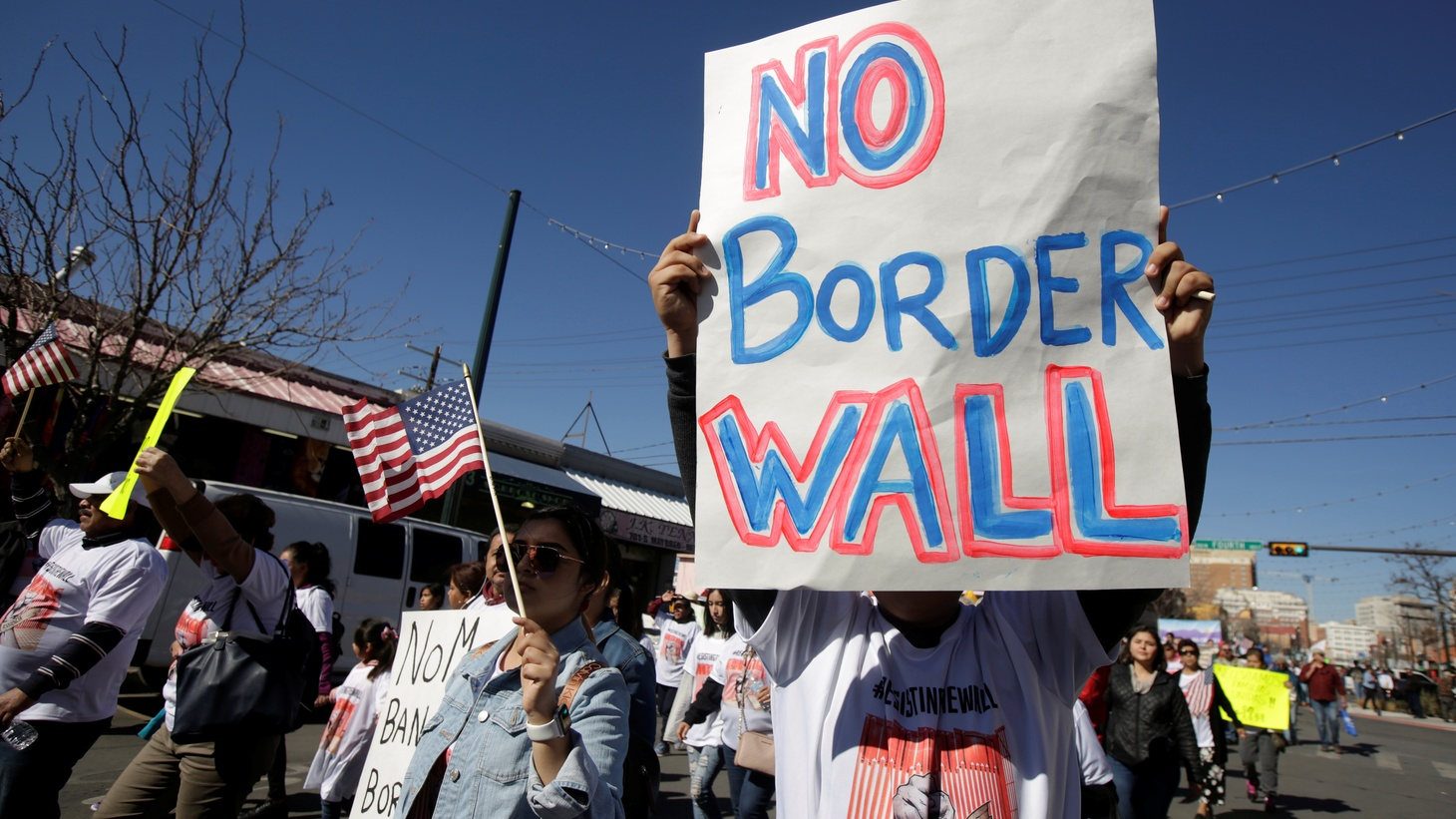 A man holds a sign during a march by members of Border Network for Human Rights to protest against U.S. President Donald Trump's proposed wall, in El Paso, Texas, U.S. January 26, 2019.