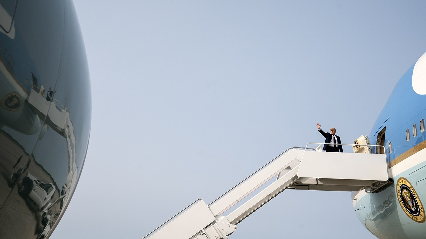 President Donald J. Trump waves as he boards Air Force One at Joint Base Andrews, Md. Tuesday, Sept. 15, for his flight to Philadelphia International Airport in Philadelphia.