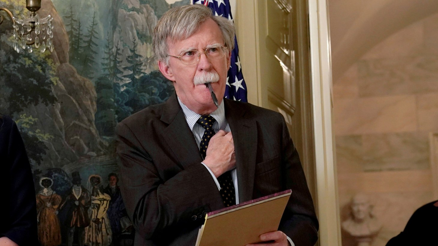 National Security Adviser John Bolton listens to U.S. President Donald Trump's statement on Syria at the White House in Washington, U.S., April 13, 2018. Picture taken April 13, 2018.