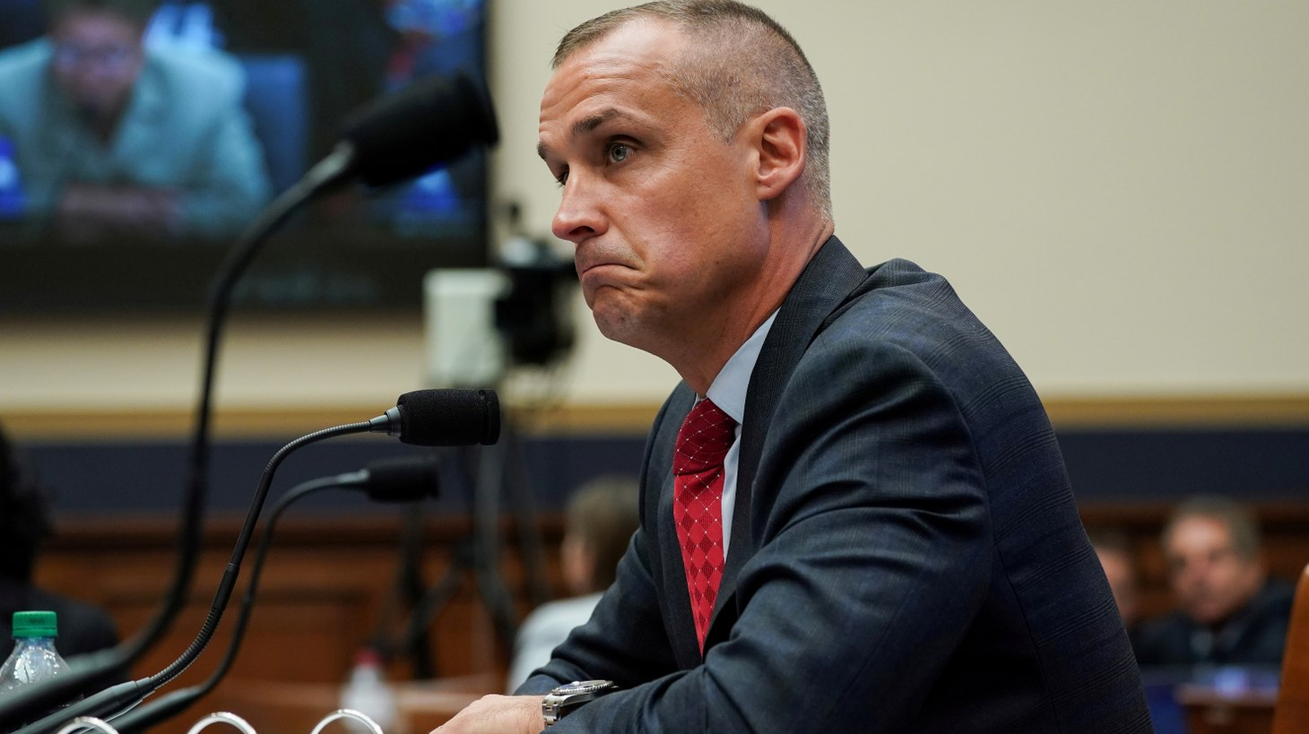 "Former Trump campaign manager Corey Lewandowski reviews sections of the former Special Counsel Robert Mueller's investigation as he testifies before the House Judiciary Committee on ""Presidential Obstruction of Justice and Abuse of Power,"" in the Rayburn House Office Building on Capitol Hill in Washington, U.S., September 17, 2019."