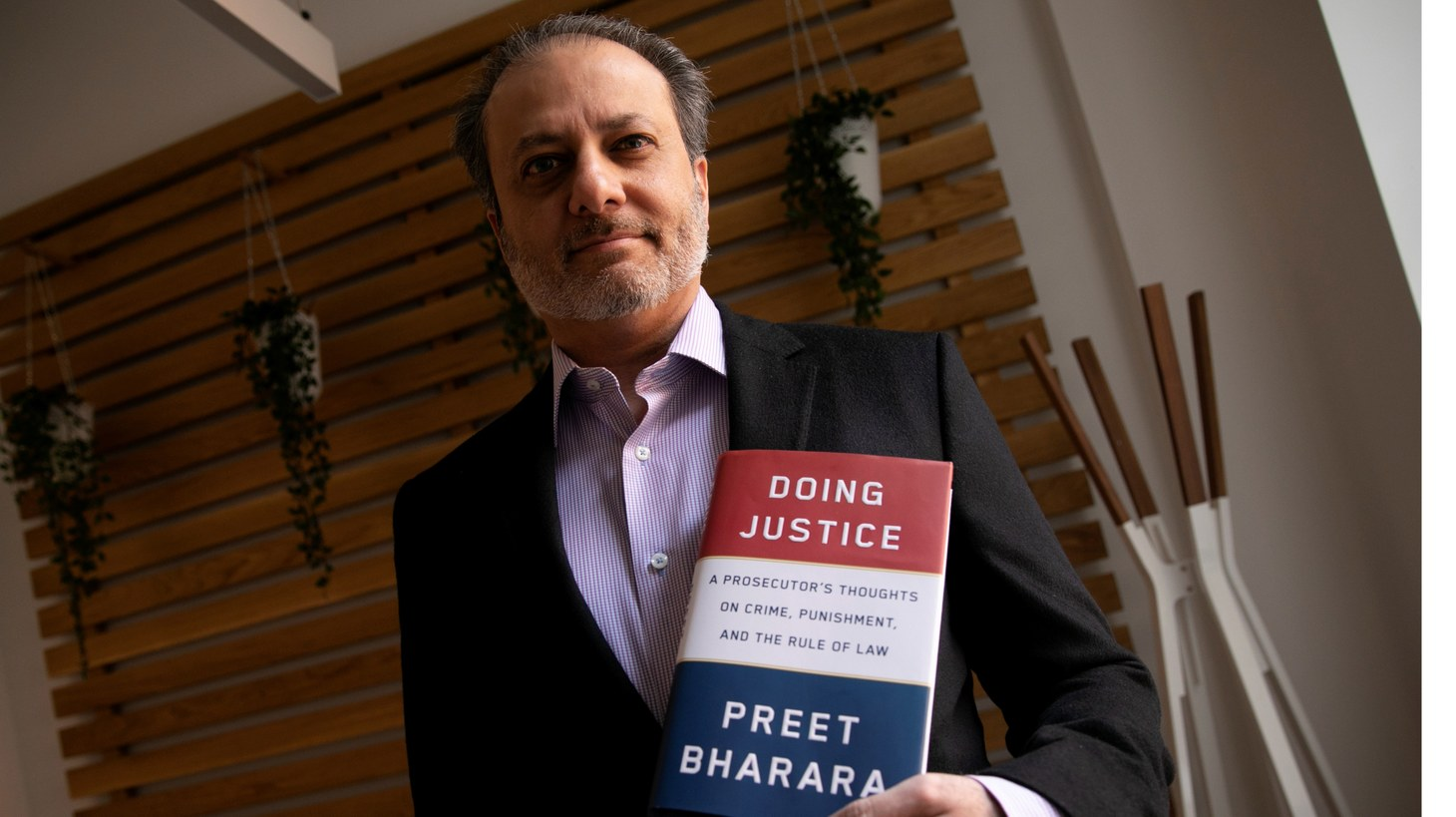 """Former U.S. Attorney for the Southern District of New York Preet Bharara poses for a photograph during an interview with Reuters ahead of the release of his book """"Doing Justice: A Prosecutors Thoughts on Crime, Punishment and the Rule of Law"""" in New York City, New York, U.S. March 13, 2019. Picture taken March 13, 2019."""