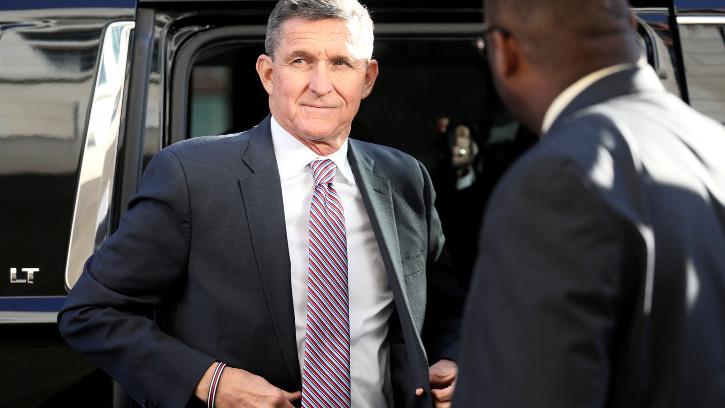 Former national security adviser Michael Flynn exits a vehicle as he arrives for his sentencing hearing at U.S. District Court in Washington, U.S., December 18, 2018.