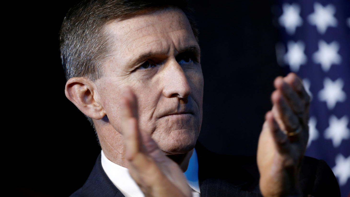 Retired U.S. Army Lieutenant General Michael Flynn reacts at a campaign event for then Republican presidential nominee Donald Trump in Herndon, Virginia, U.S., October 3, 2016.
