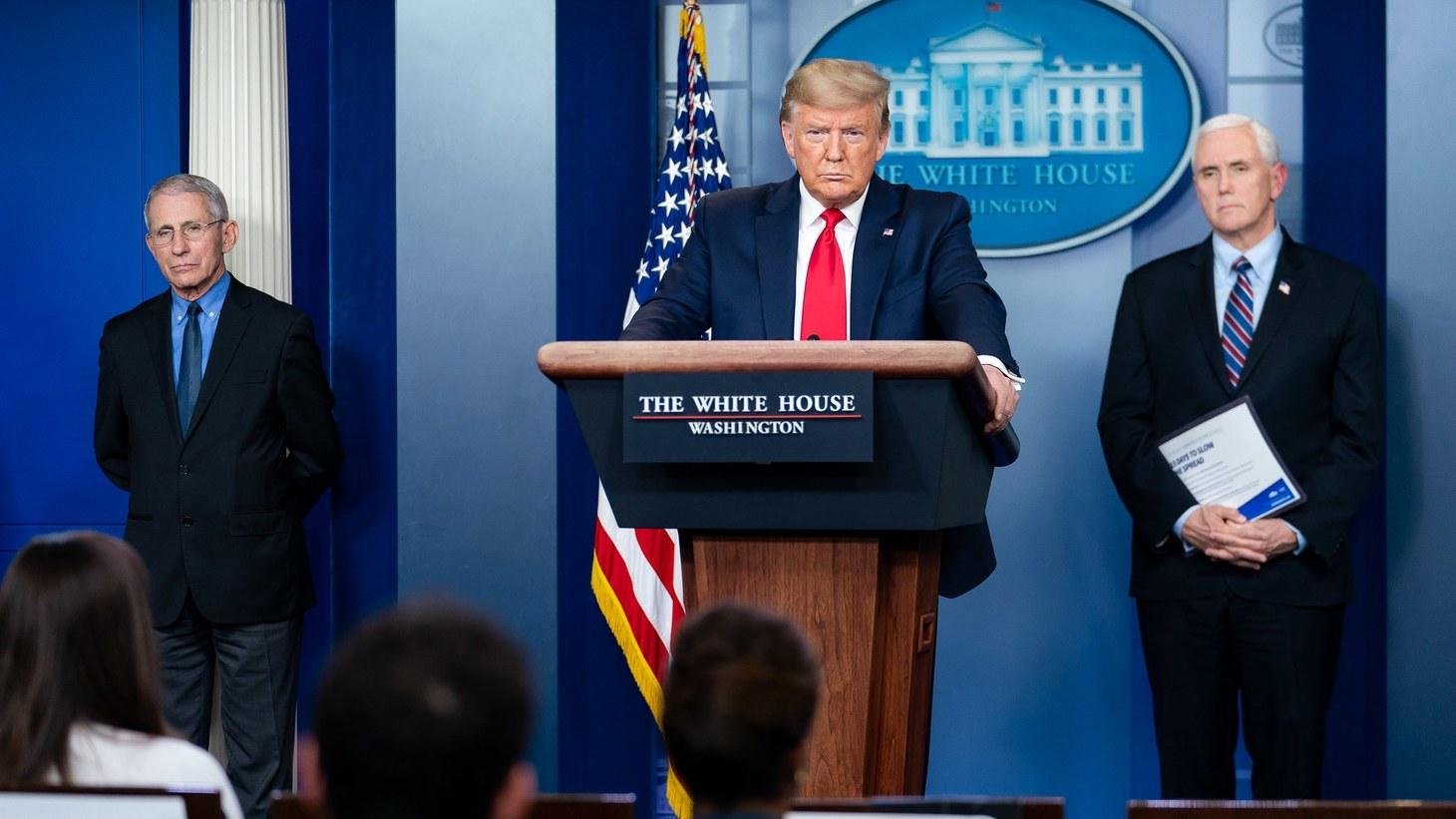 President Donald J. Trump, joined by Vice President Mike Pence and members of the White House Coronavirus Task Force, listens to a reporter's question at the coronavirus (COVID-19) update briefing Thursday, March 26, 2020.