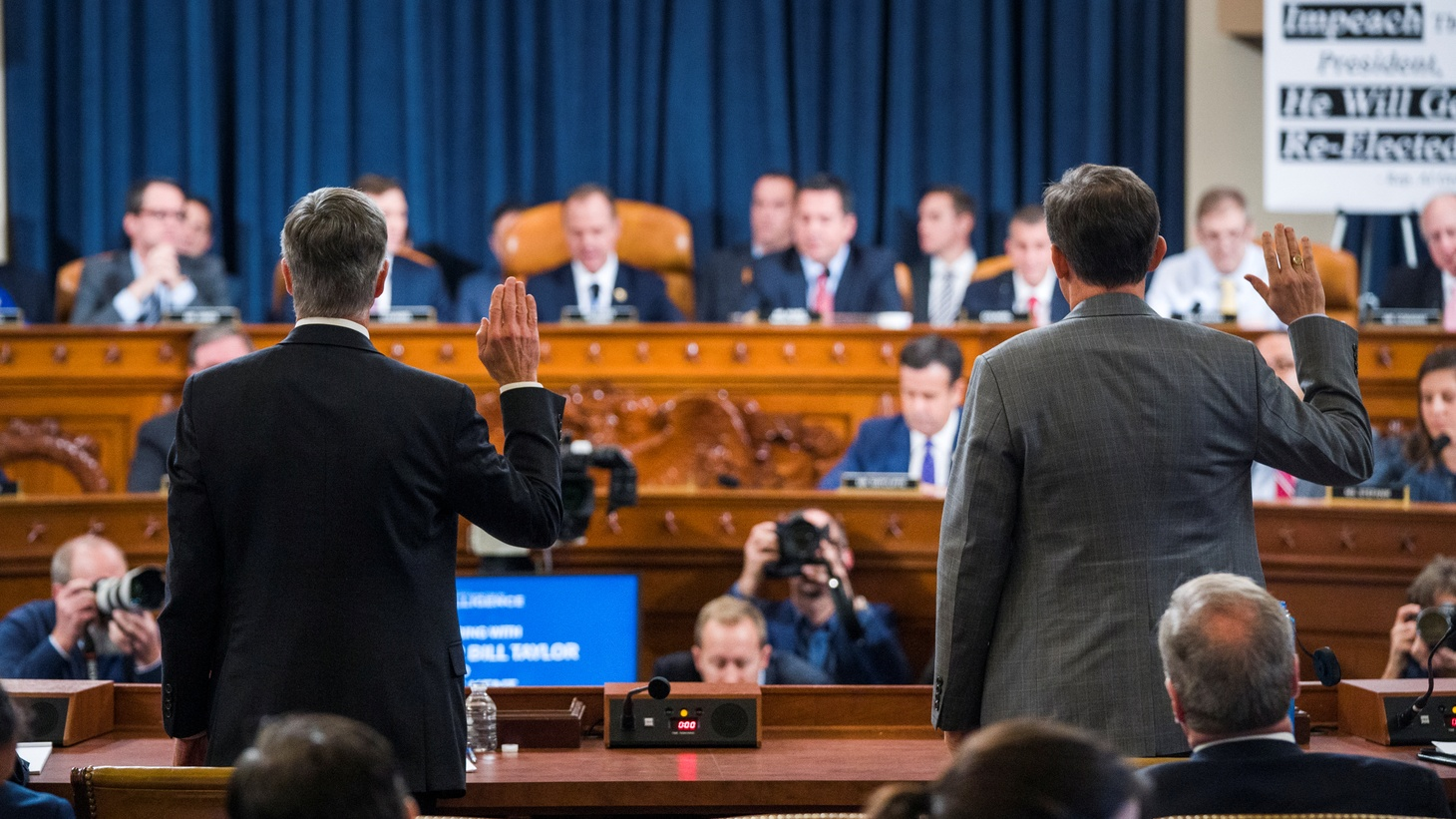 Charge d'Affaires at the US embassy in Ukraine Bill Taylor (L) and Deputy Assistant Secretary of State for Europe and Eurasia George Kent (R) are sworn in to testify before the House Permanent Select Committee on Intelligence hearing on the impeachment inquiry into U.S. President Donald J. Trump, on Capitol Hill in Washington, DC, U.S., November 13, 2019.