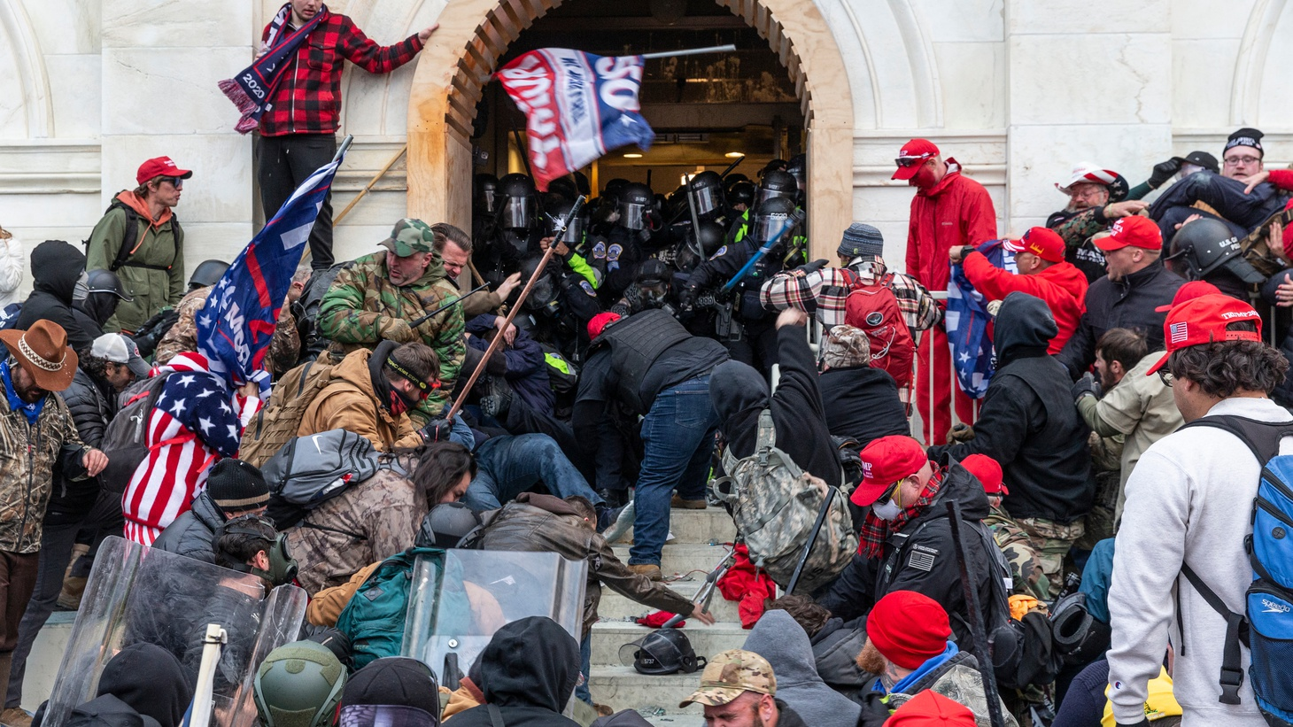 Rioters clash with police trying to enter Capitol building through the front doors.
