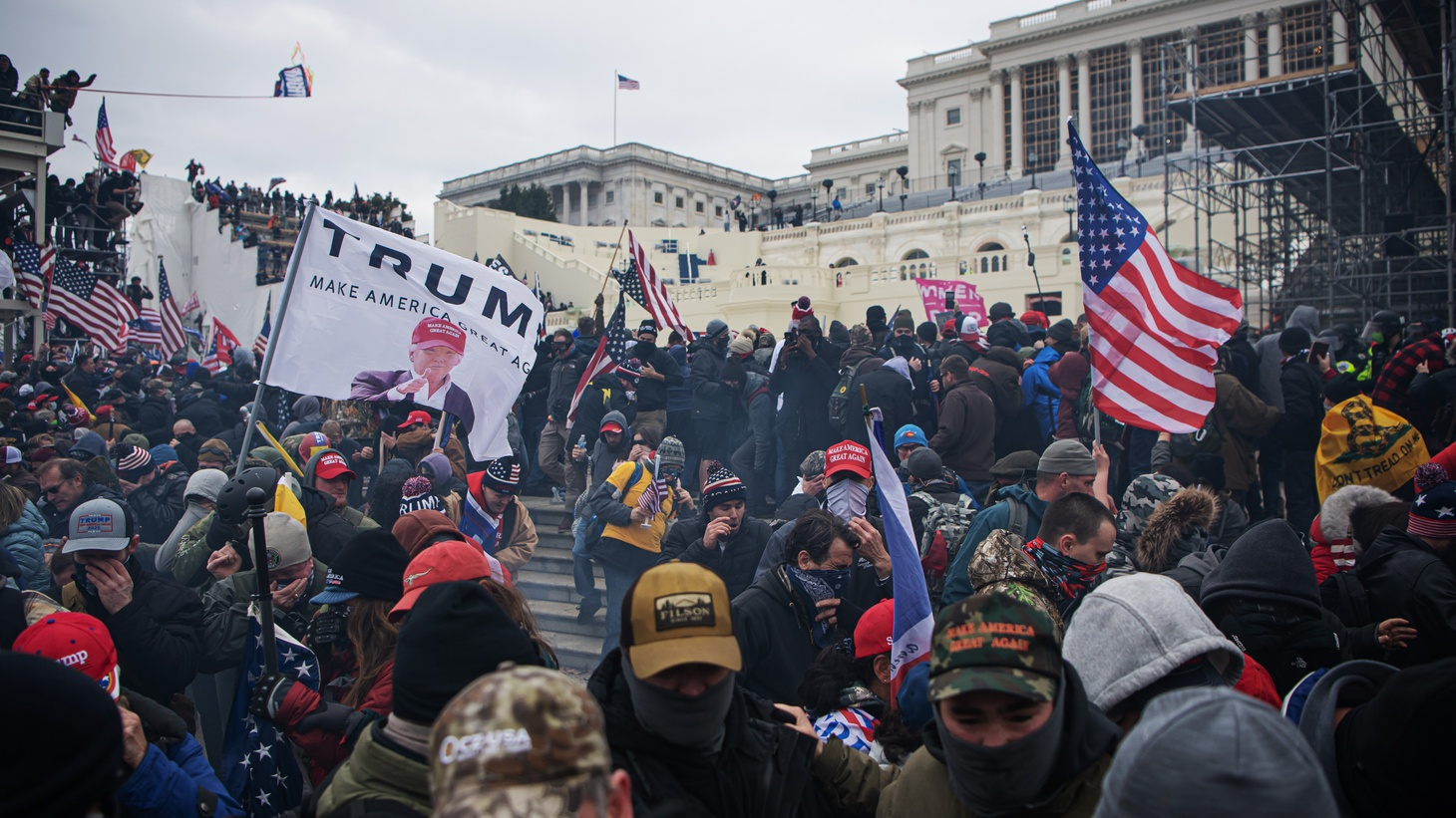 210106 People run away from tear gas as pro-Trump supporters storm the United States Capitol Building after a March to Save America Rally on January 6, 2021 in Washington, DC, USA.