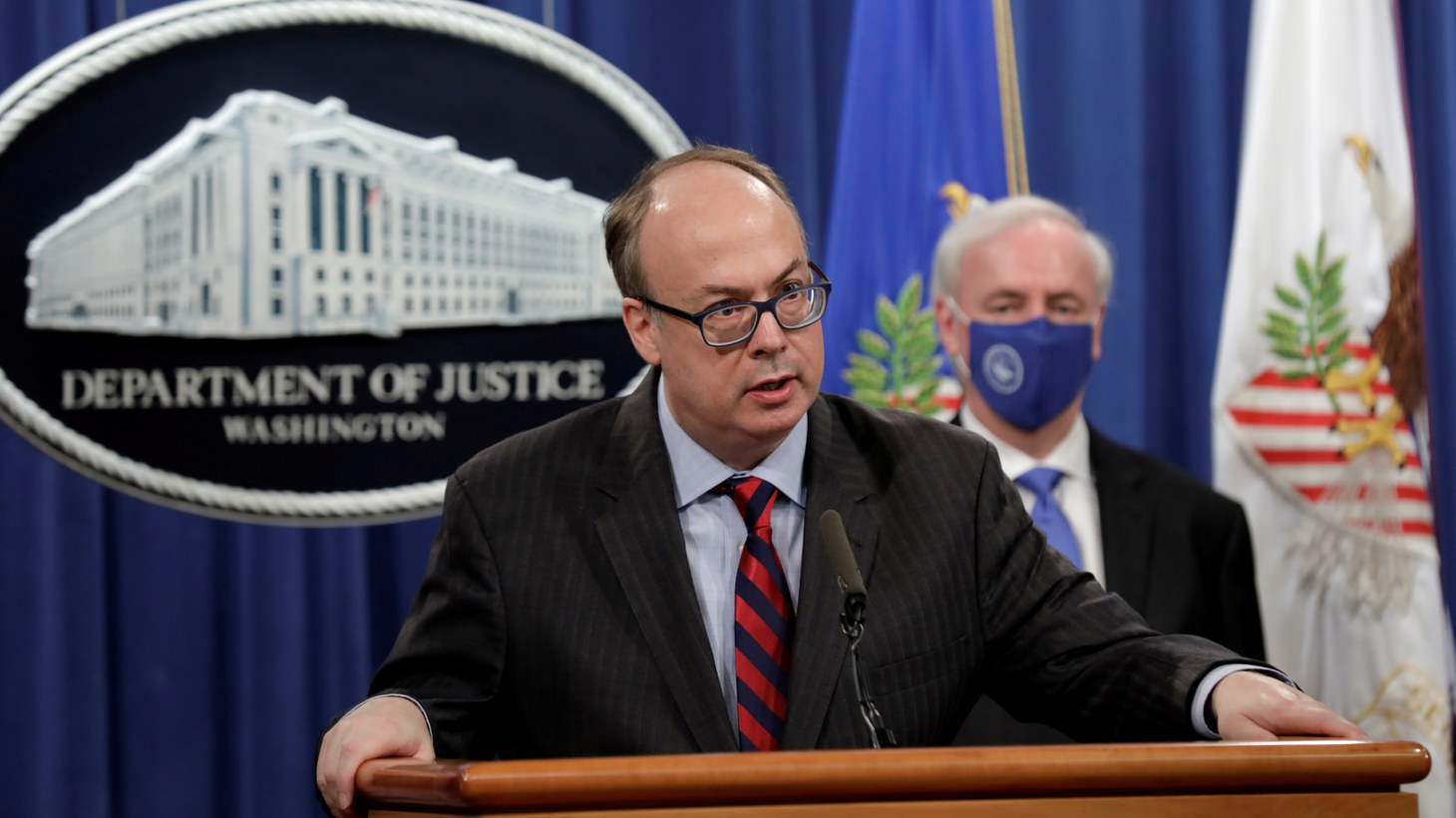 Acting Assistant U.S. Attorney General Jeffrey Clark speaks next to Deputy U.S. Attorney General Jeffrey Rosen at a news conference, where they announced that Purdue Pharma LP has agreed to plead guilty to criminal charges over the handling of its addictive prescription opioid OxyContin, at the Justice Department in Washington, U.S., October 21, 2020.