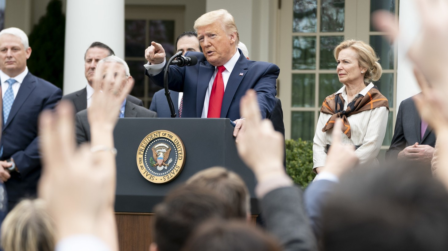 President Donald J. Trump points to a reporter to ask a question after announcing a national emergency to further combat the Coronavirus outbreak, at a news conference Friday, March 13, 2020, in the Rose Garden of the White House.