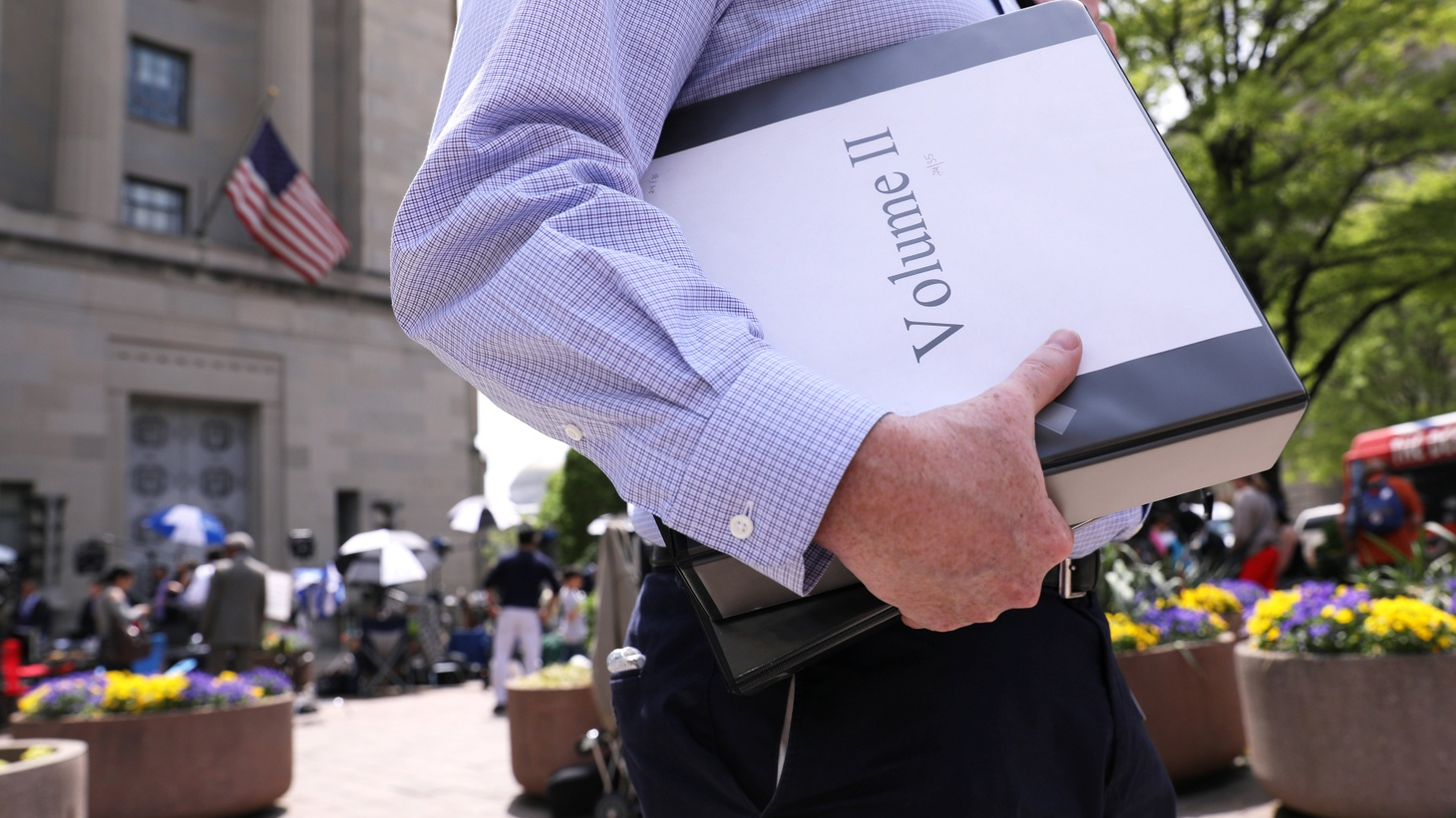 A reporter departs with his official copy of Special Counsel Robert Mueller's report on Russian interference in the 2016 U.S. presidential election, outside the Department of Justice in Washington, U.S., April 18, 2019.