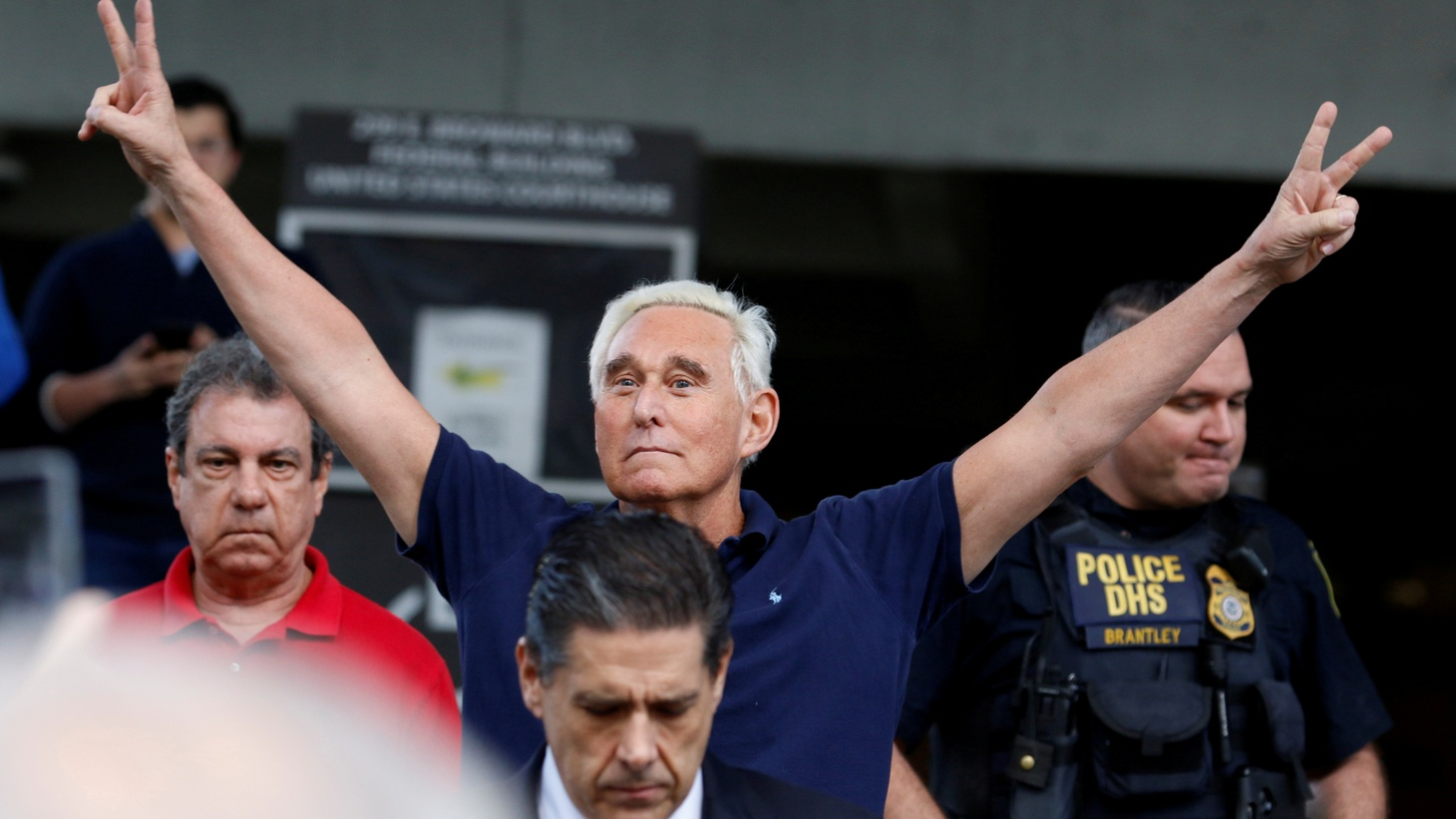 Roger Stone reacts as he walks to microphones after his appearance at Federal Court in Fort Lauderdale, Florida, U.S., January 25, 2019.