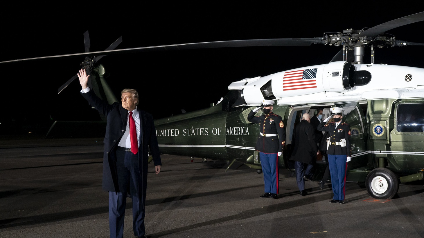 President Donald J. Trump waves as he prepares to board Marine One at Dalton Municipal Airport in Dalton, Ga., Tuesday, Jan. 4, 2021, after addressing a rally at the airport.