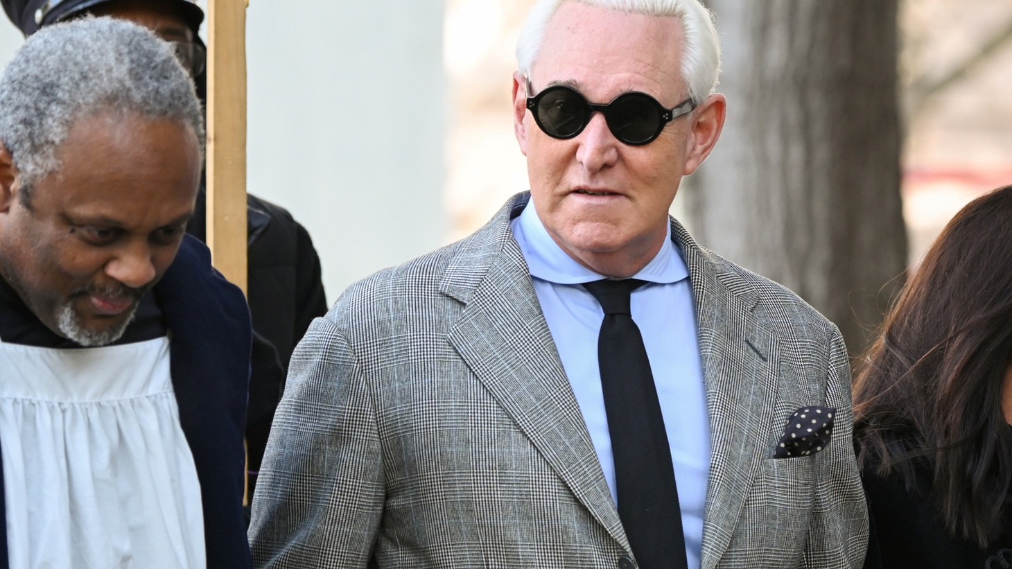 Former Trump campaign adviser Roger Stone, joined by other witnesses, arrives for his criminal trial on charges of lying to Congress, obstructing official proceeding and witness tampering at the U.S. District court in Washington, U.S. November 14, 2019.