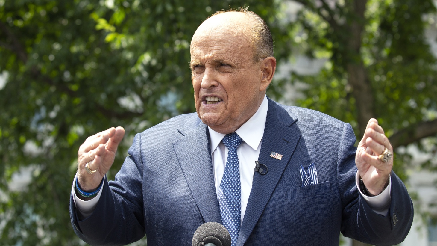 Rudy Giuliani, personal lawyer to United States President Donald J. Trump, speaks to members of the media following a television interview with One America News Network outside the White House in Washington D.C., U.S., on Wednesday, July 1, 2020.