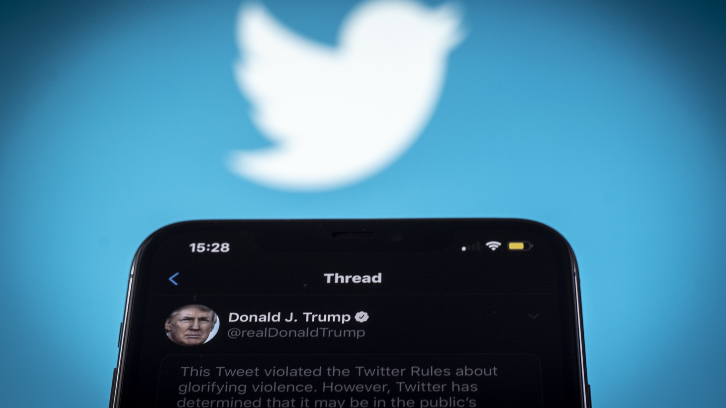 A tweet by US president Donald Trump is seen being flagged as inciting violence by Twitter in this photo illustration on an Apple iPhone in Warsaw, Poland on May 29, 2020. Twitter on May 29 applied a fact-checking label to a vote-in-mail tweet by US President Donald Trump that the company considers misleading. Twitter has recently started labelling tweets with public notification and fact check labels. The labelling of Trump's tweet about the uproar following the death of George Floyd has seen the president signing an executive order targeting the Communications Decency Act. Section 230 which protects social media companies against lawsuits against them for user generated content.