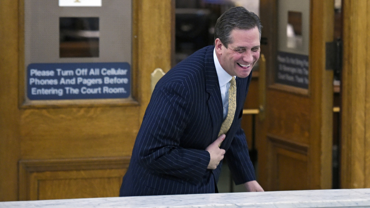 Former Montgomery County District Attorney Bruce Castor shares a laugh with a person (not in photo) as he leaves Montgomery County Courtroom A after spending all day on the witness stand in a pre-trail hearing for entertainer Bill Cosby and his sexual assault case in Norristown, Pennsylvania, February 2, 2016. Castor testified on Tuesday that he decided in 2005 not to bring charges over the Constand allegations.