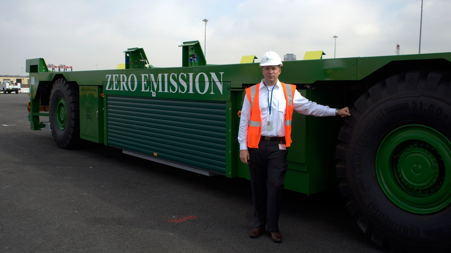 The 2008 economic crash fundamentally changed the ports of Los Angeles and Long Beach, bringing in bigger ships and new technology to handle all challenges of staying competitive.       Harbor Commission Vice President Rich Dines poses in front of one of the Port of Long Beach's new AGV's, or Automated Guided Vehicles. Photo credit: Lu Okowski