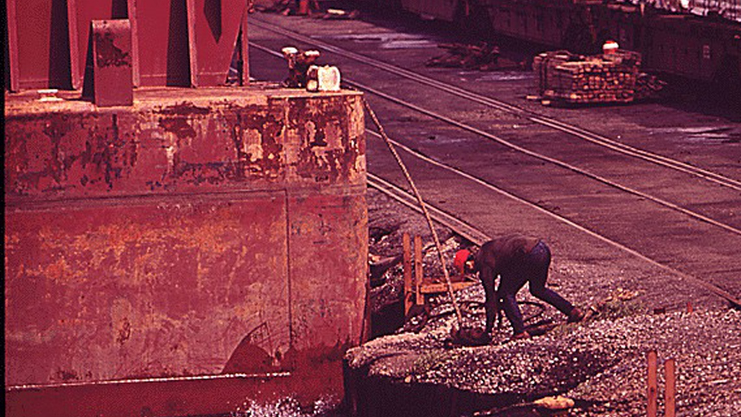 Harold Erickson recalls one hot day unloading steel from deep in the bottom of a ship, when all of the sudden someone offered him an ice cold Manhattan. It's a gestured he'll never forget.       Working the steel dock in 1973. Photo Credit: The Environmental Protection Agency