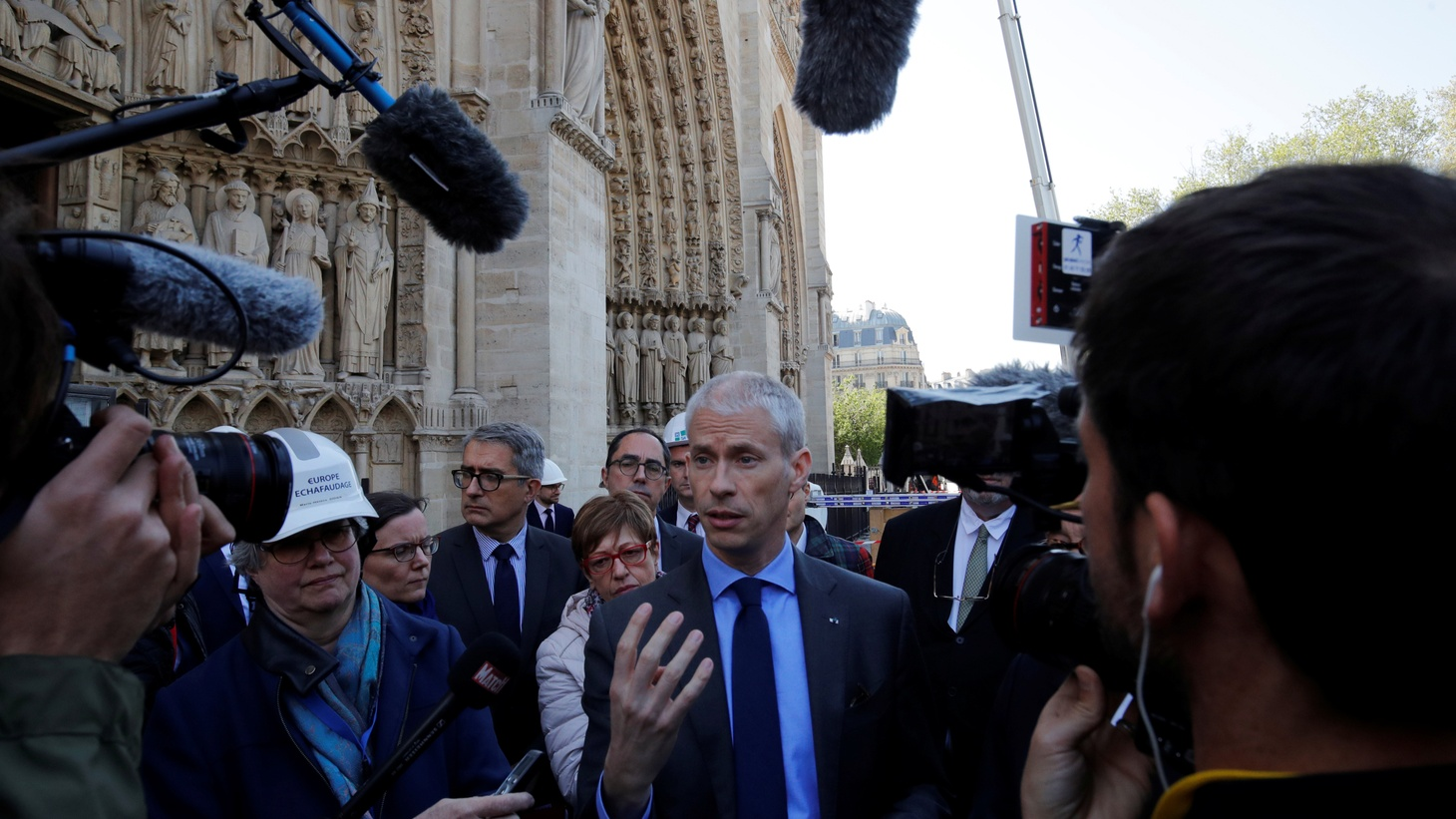 French Culutre Minister Franck Riester talks to journalists in front of the Notre-Dame Cathedral about the securing of the large artworks after a massive fire devastated large parts of the gothic structure in Paris, France, April 19, 2019.