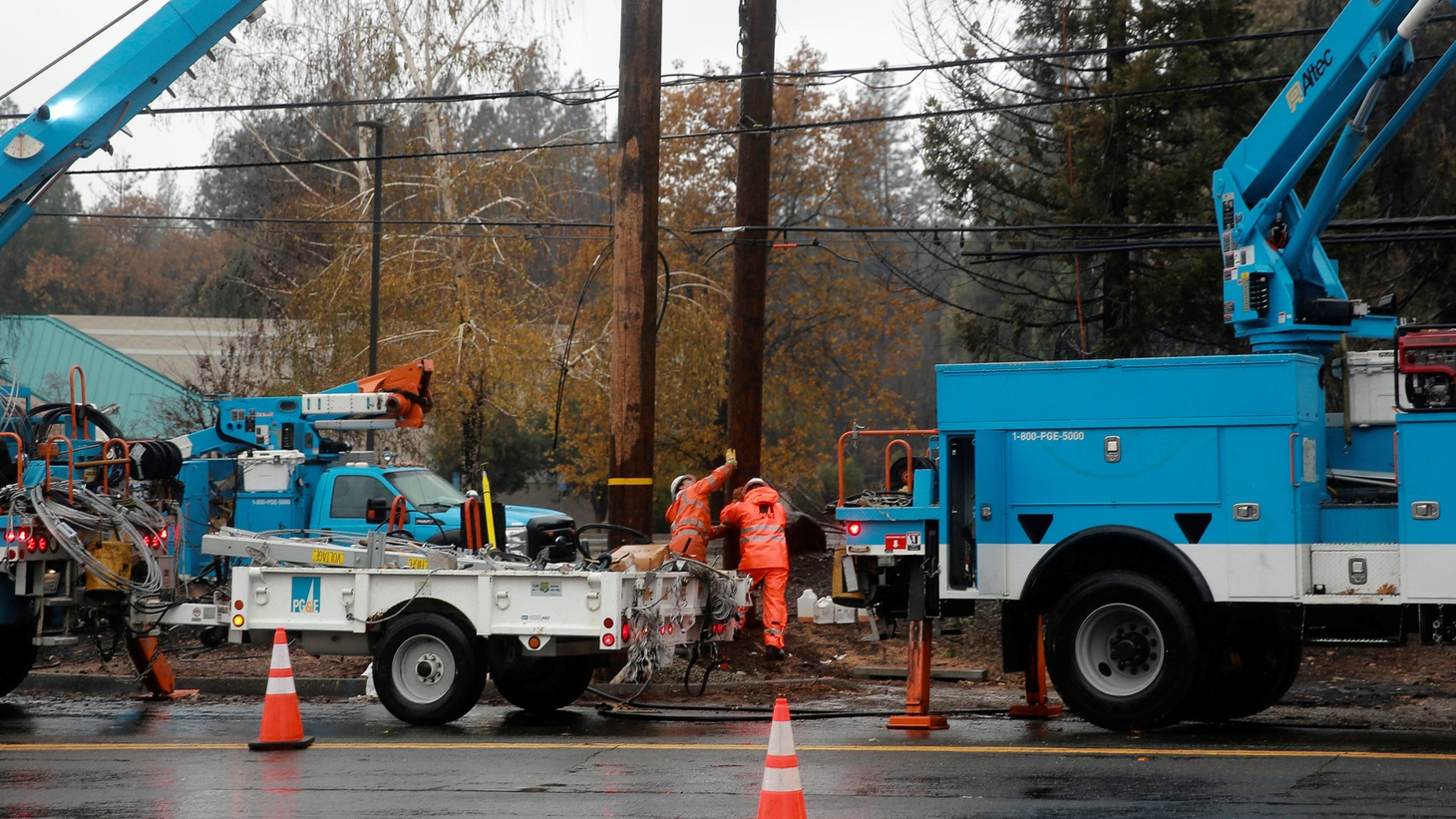 PG&E works on power lines to repair damage caused by the Camp Fire in Paradise, California, U.S. November 21, 2018.