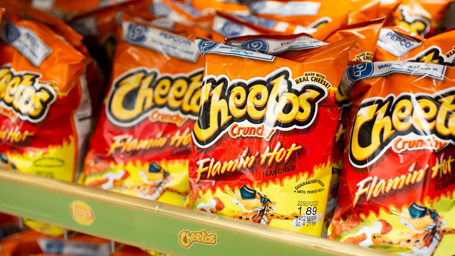 Richard Montañez climbed the ranks at Frito-Lay, and after retiring, he pushed out the story that he developed Flamin' Hot Cheetos. But it turns out that the product was based on a regional hot chip found in inner-city mini markets across Chicago and Detroit, says LA Times reporter Sam Dean.