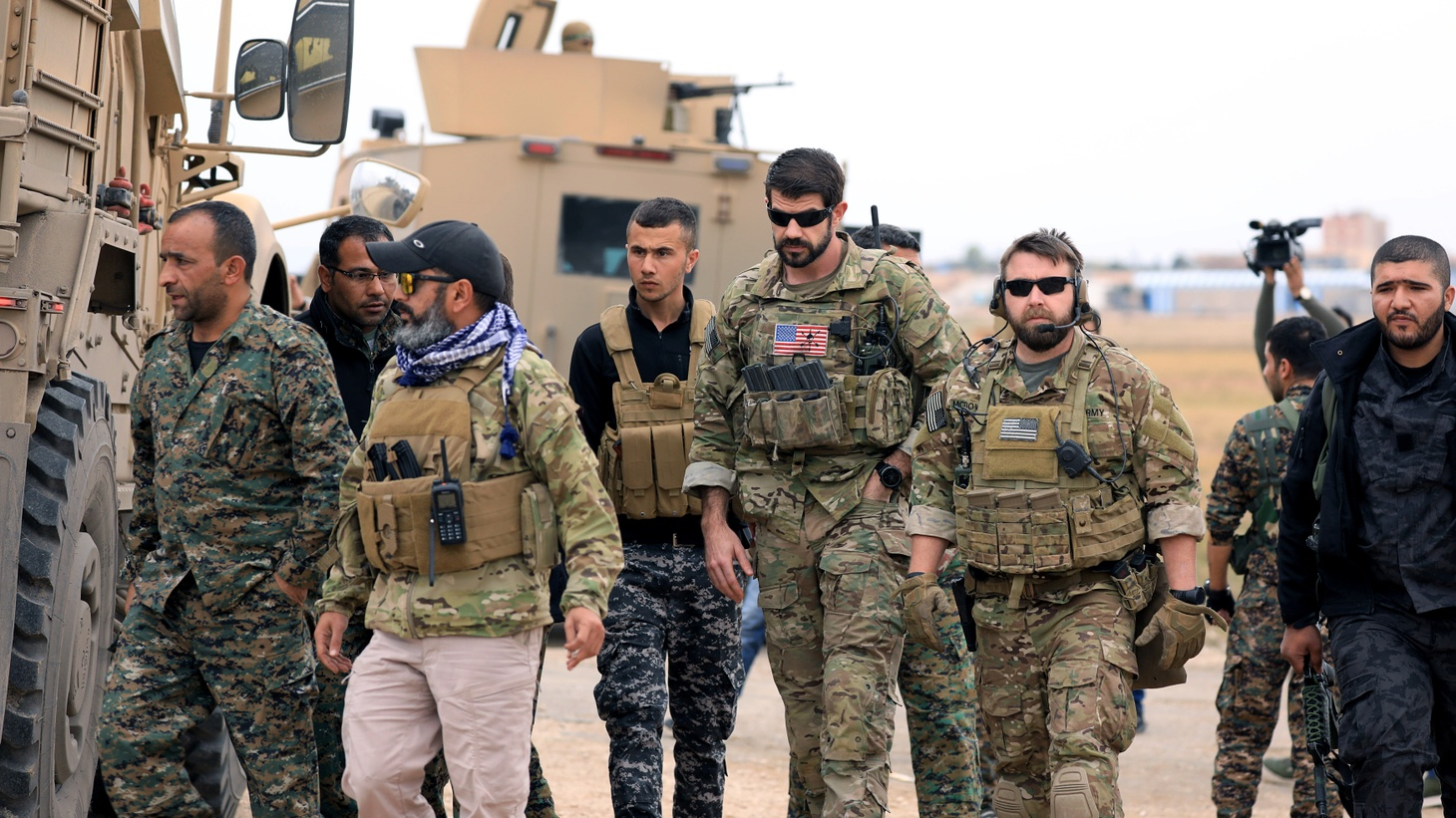 Syrian Democratic forces and U.S. troops during a patrol near the Turkish border in Hasakah, Syria. November 4, 2018.