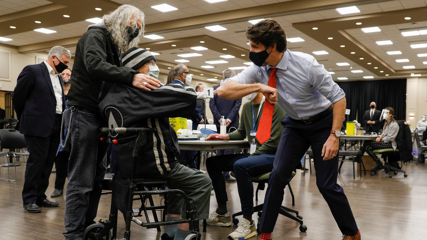 Canada's Prime Minister Justin Trudeau elbow-bumps a patient waiting to get their COVID-19 vaccination at a clinic, as efforts continue to help slow the spread of the coronavirus disease, in Ottawa, Ontario, Canada March 30, 2021.