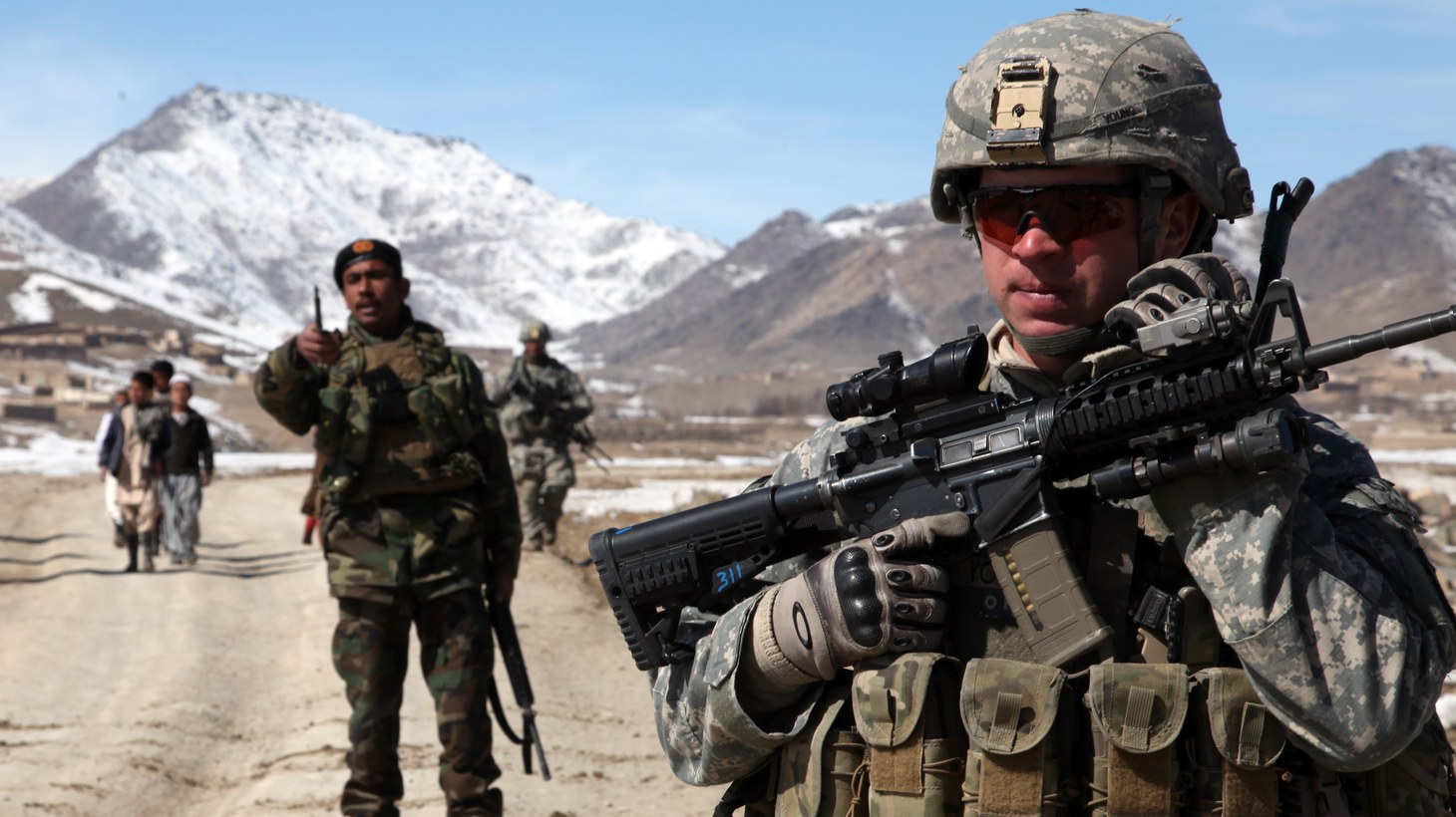 A U.S. Army soldier conducts a patrol with a platoon of Afghan national army soldiers to check on conditions in the village of Yawez, Wardak province, Afghanistan, Feb. 17, 2010.